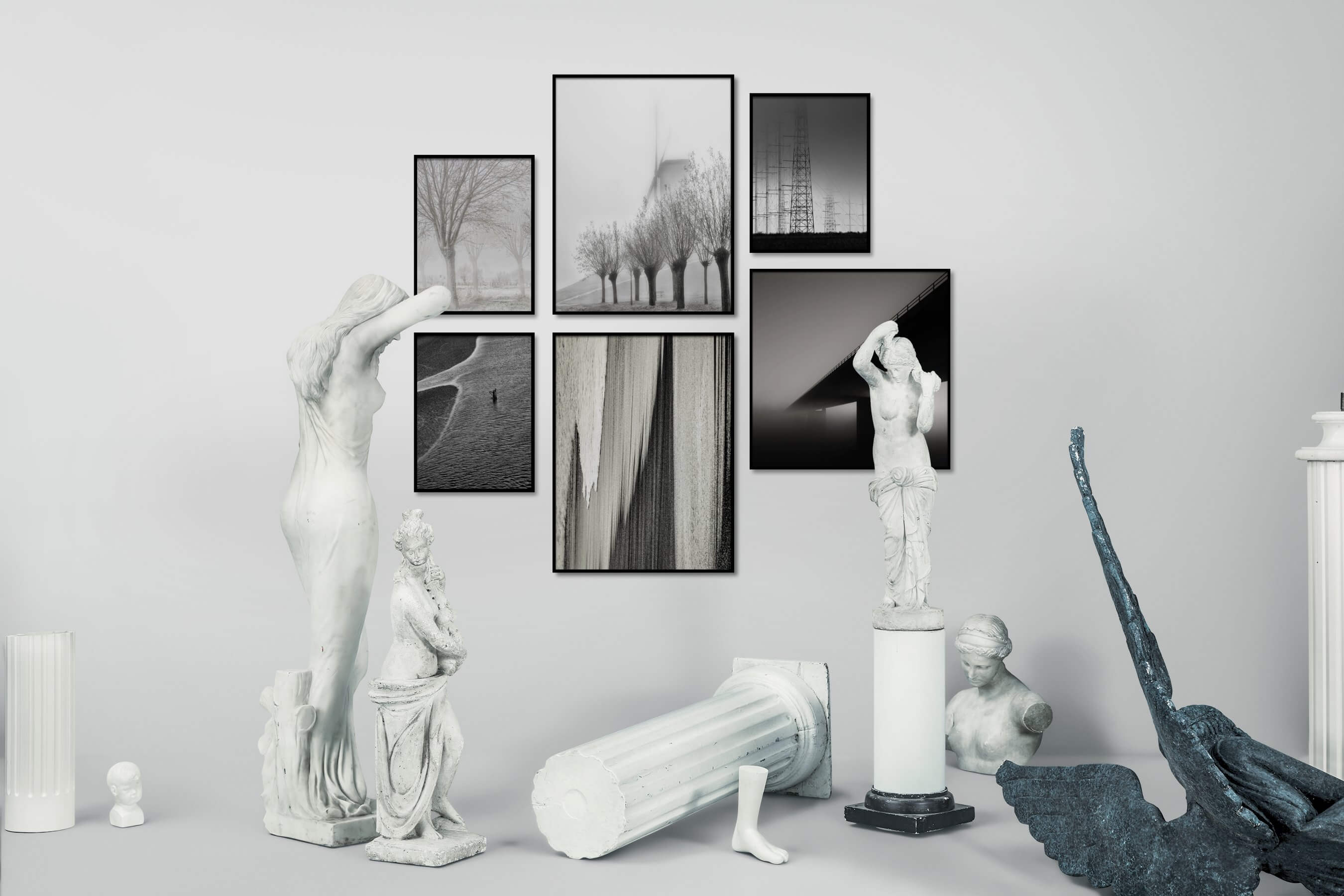Gallery wall idea with six framed pictures arranged on a wall depicting Country Life, Black & White, For the Moderate, Beach & Water, and For the Minimalist