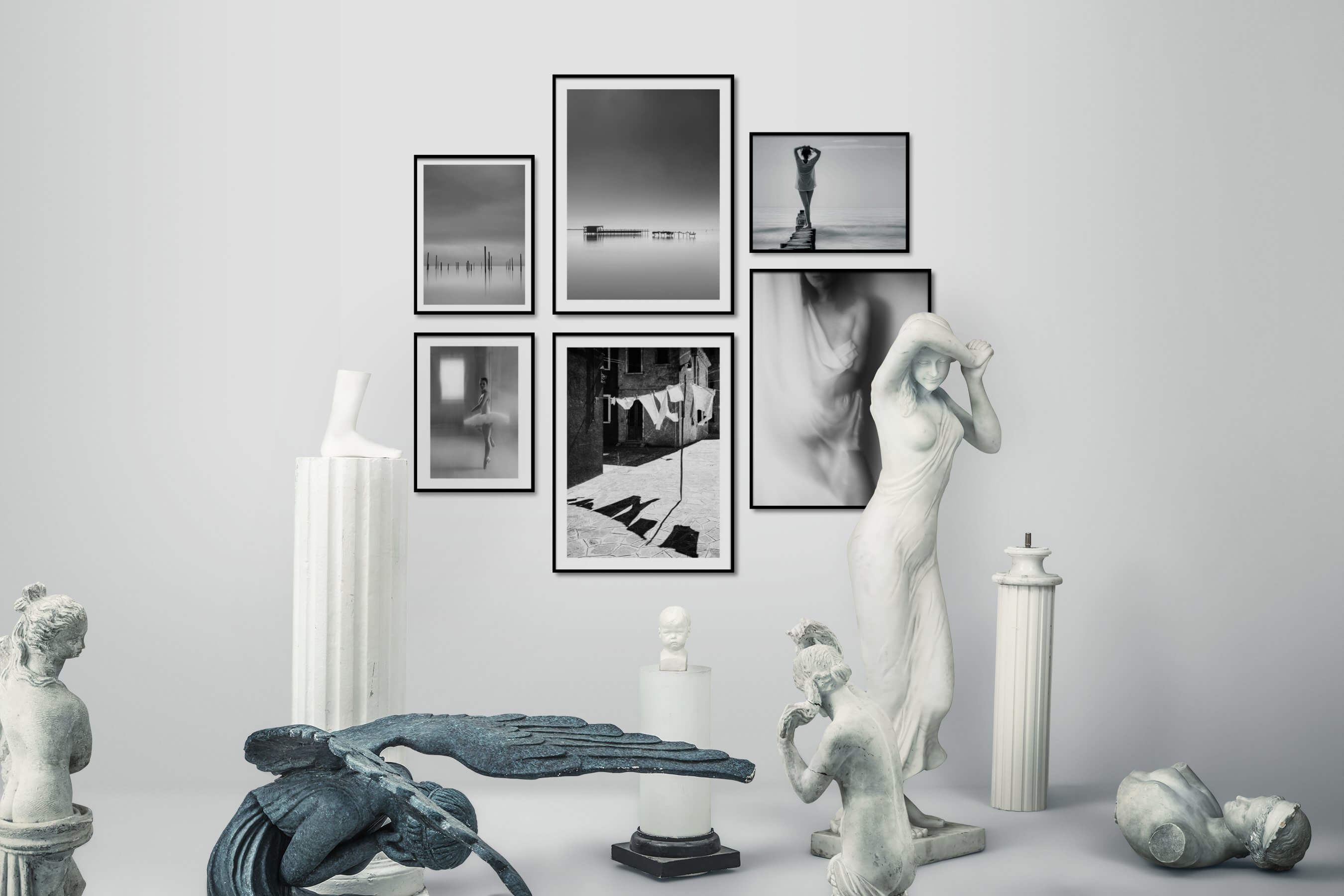 Gallery wall idea with six framed pictures arranged on a wall depicting Black & White, For the Minimalist, Beach & Water, Mindfulness, Fashion & Beauty, and City Life