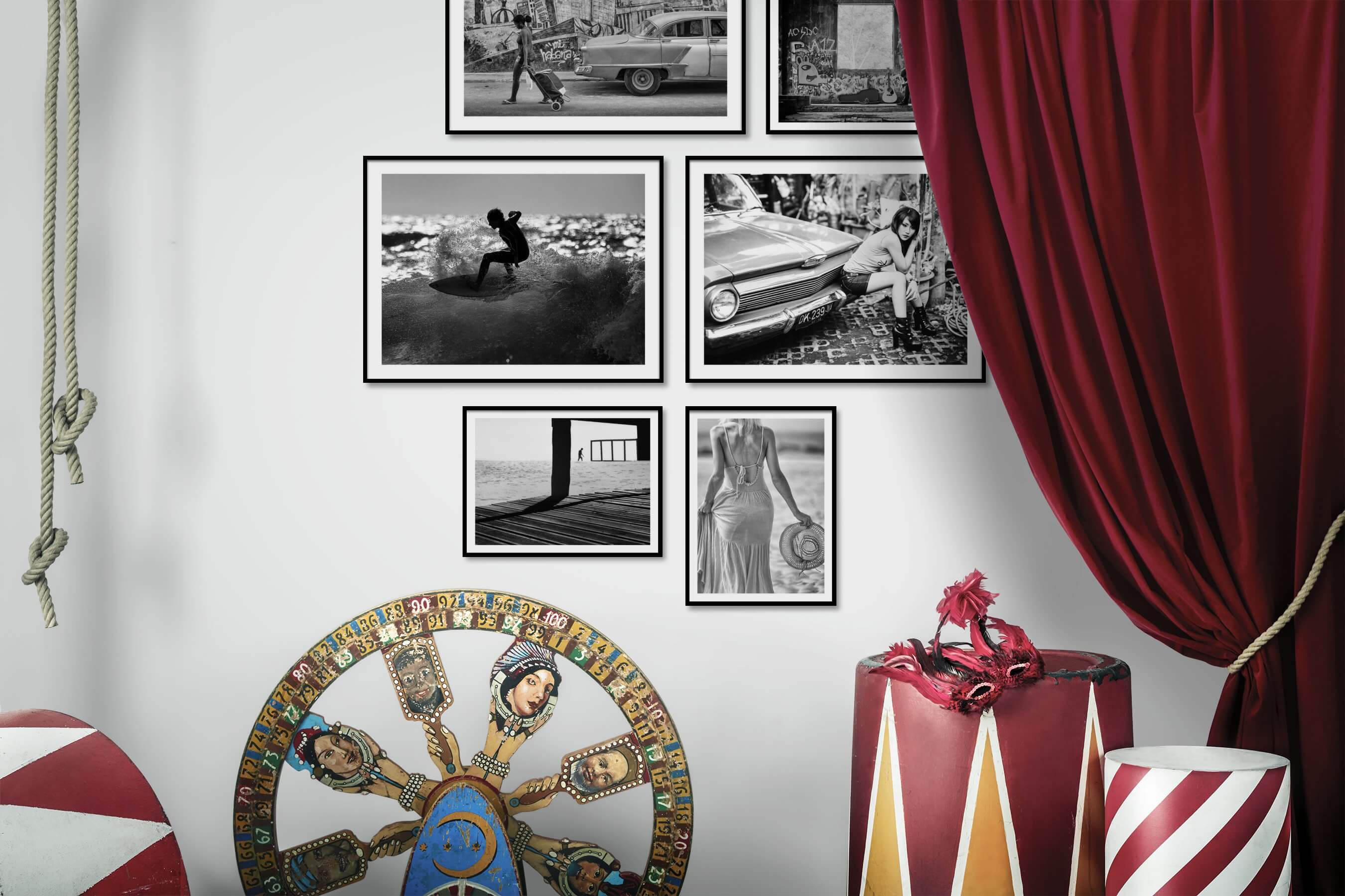 Gallery wall idea with six framed pictures arranged on a wall depicting Black & White, City Life, Vintage, Beach & Water, Fashion & Beauty, and For the Moderate