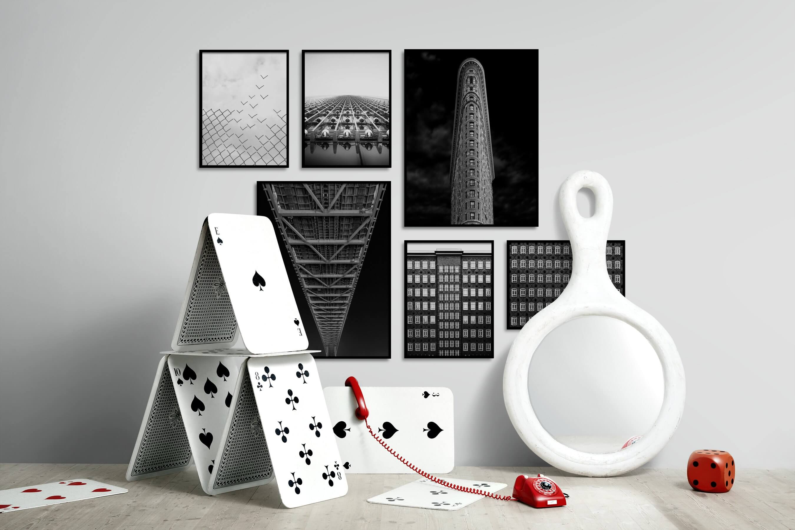 Gallery wall idea with six framed pictures arranged on a wall depicting Black & White, For the Moderate, Dark Tones, City Life, For the Minimalist, and Americana