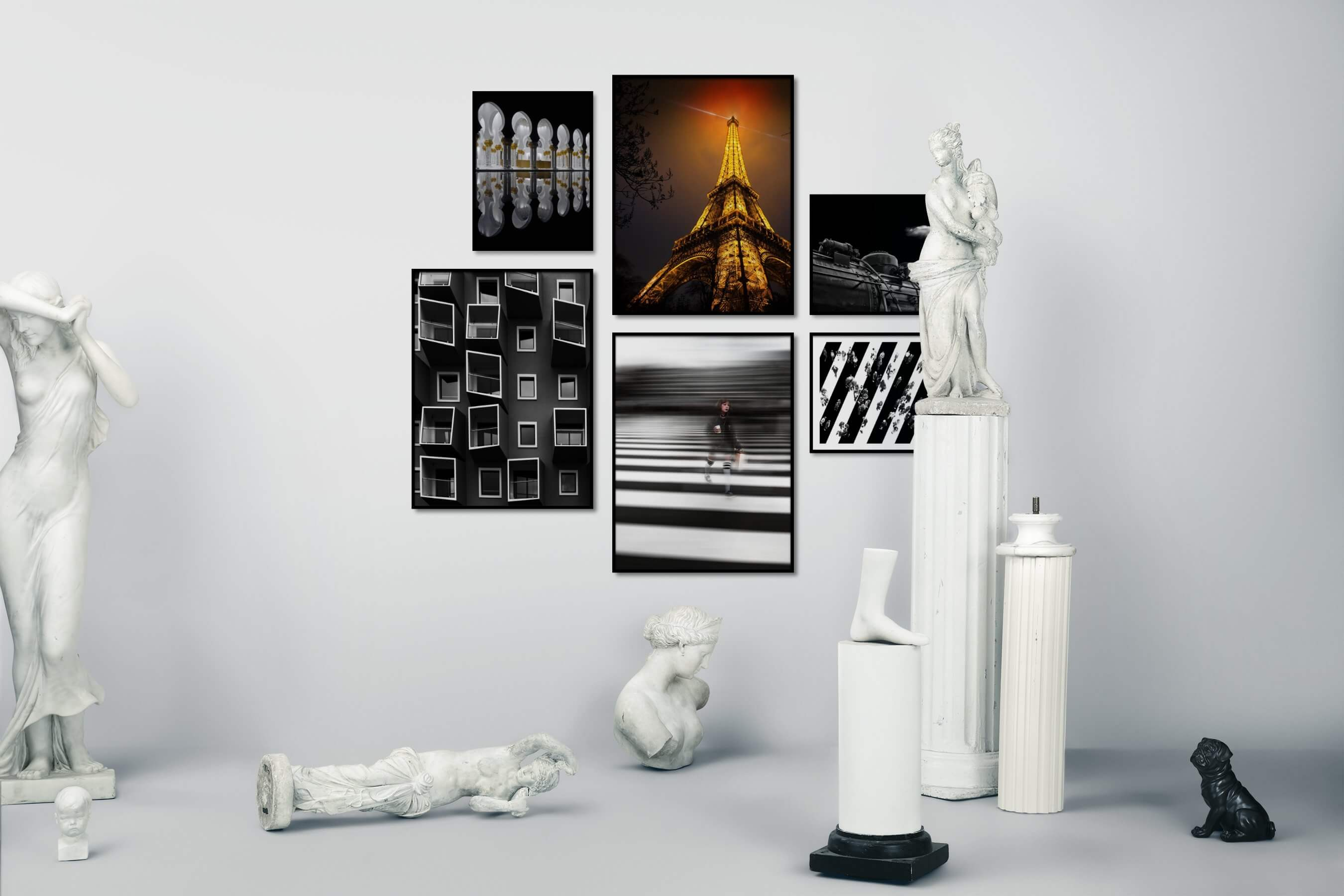 Gallery wall idea with six framed pictures arranged on a wall depicting Dark Tones, For the Moderate, City Life, Black & White, and For the Minimalist