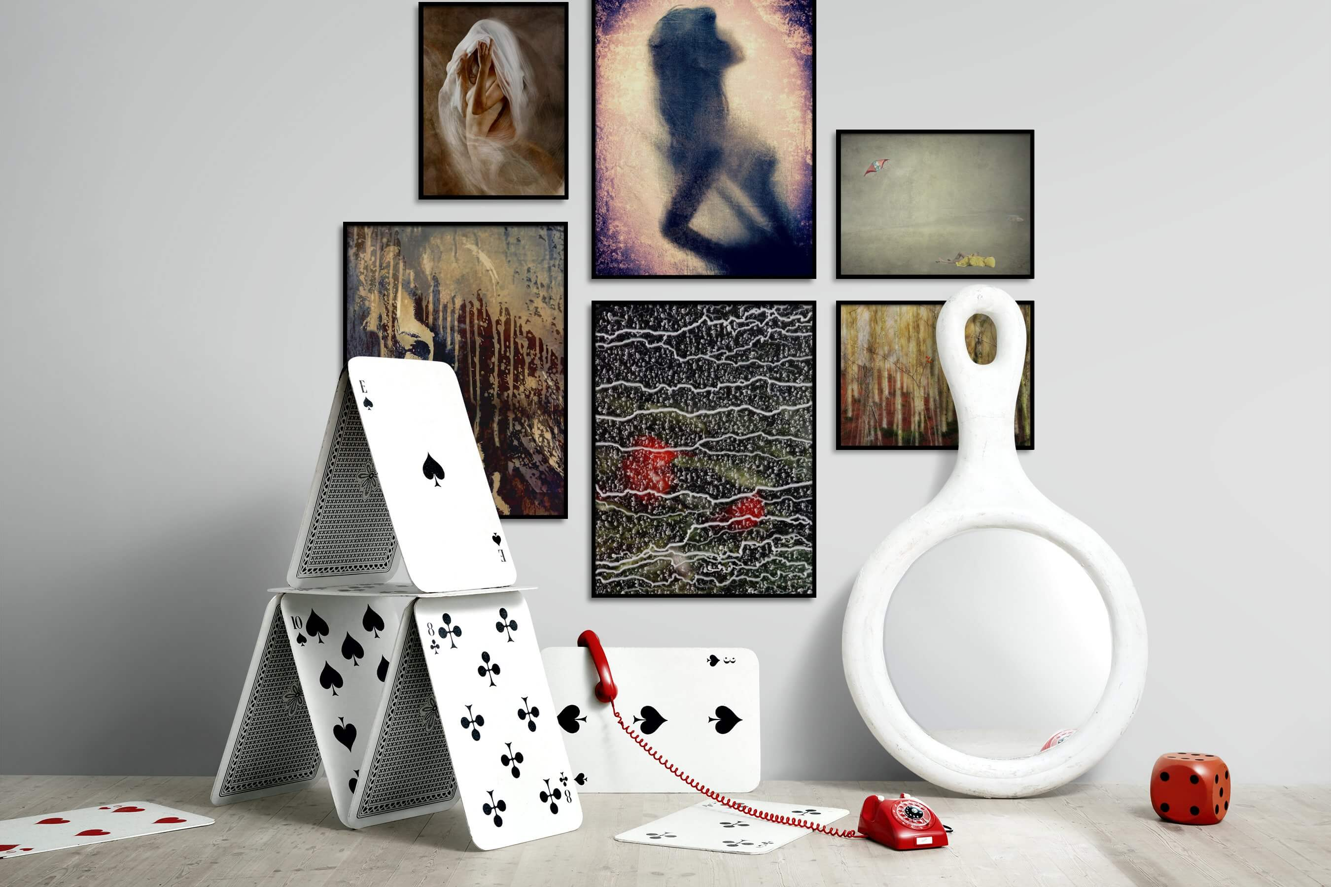 Gallery wall idea with six framed pictures arranged on a wall depicting Artsy, Fashion & Beauty, For the Maximalist, For the Minimalist, Beach & Water, Vintage, and Nature