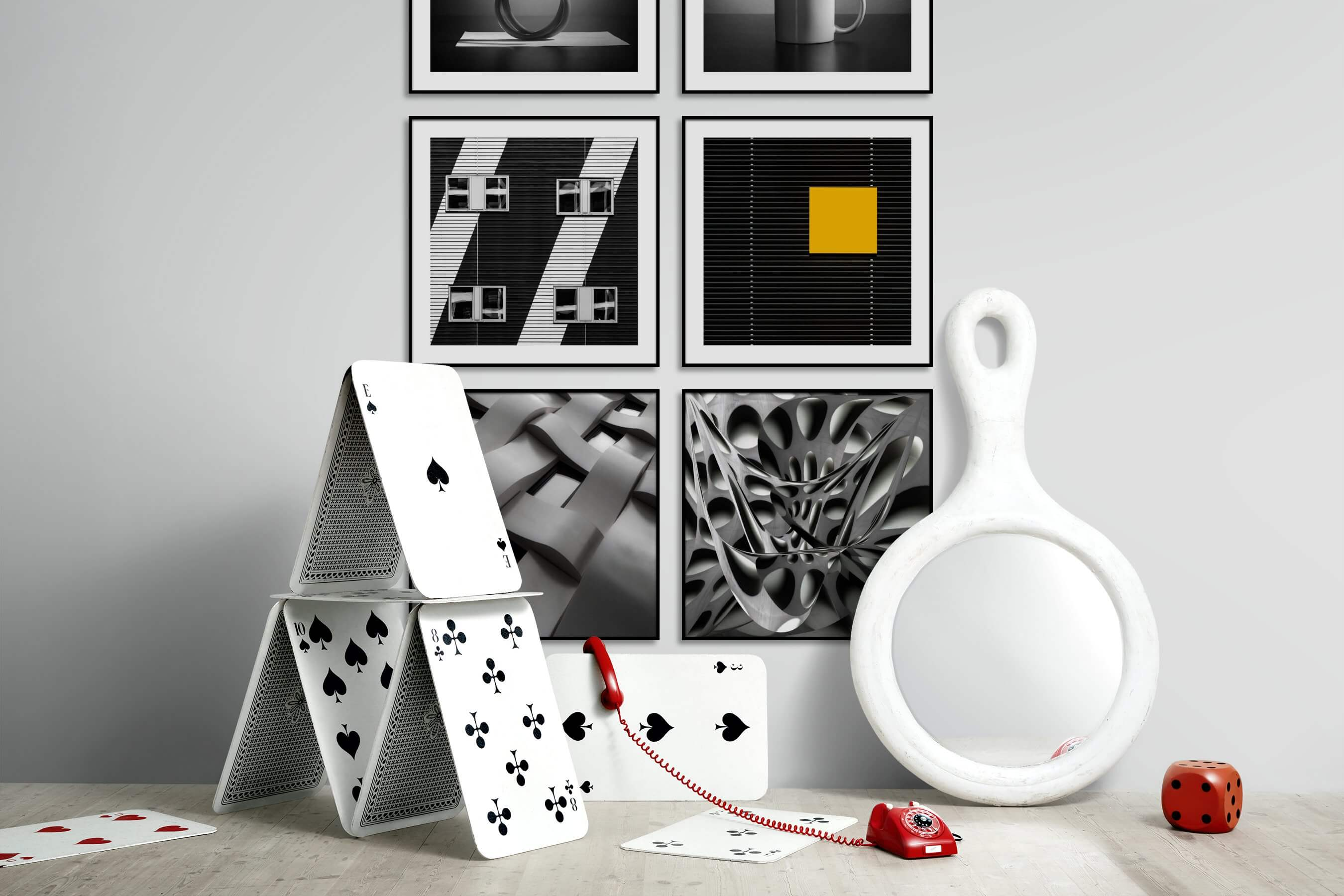 Gallery wall idea with six framed pictures arranged on a wall depicting Black & White, For the Minimalist, For the Moderate, City Life, and For the Maximalist