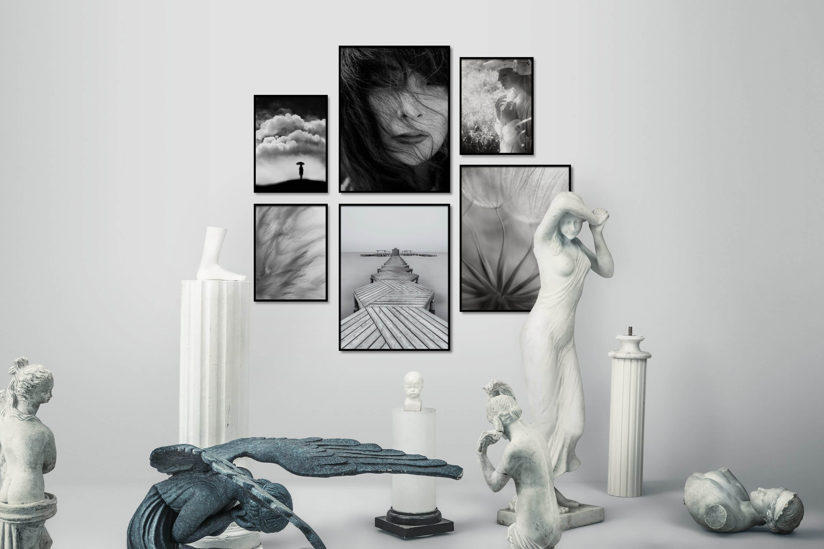 Gallery wall idea with six framed pictures arranged on a wall depicting Black & White, Country Life, Mindfulness, Fashion & Beauty, For the Moderate, Flowers & Plants, and Beach & Water