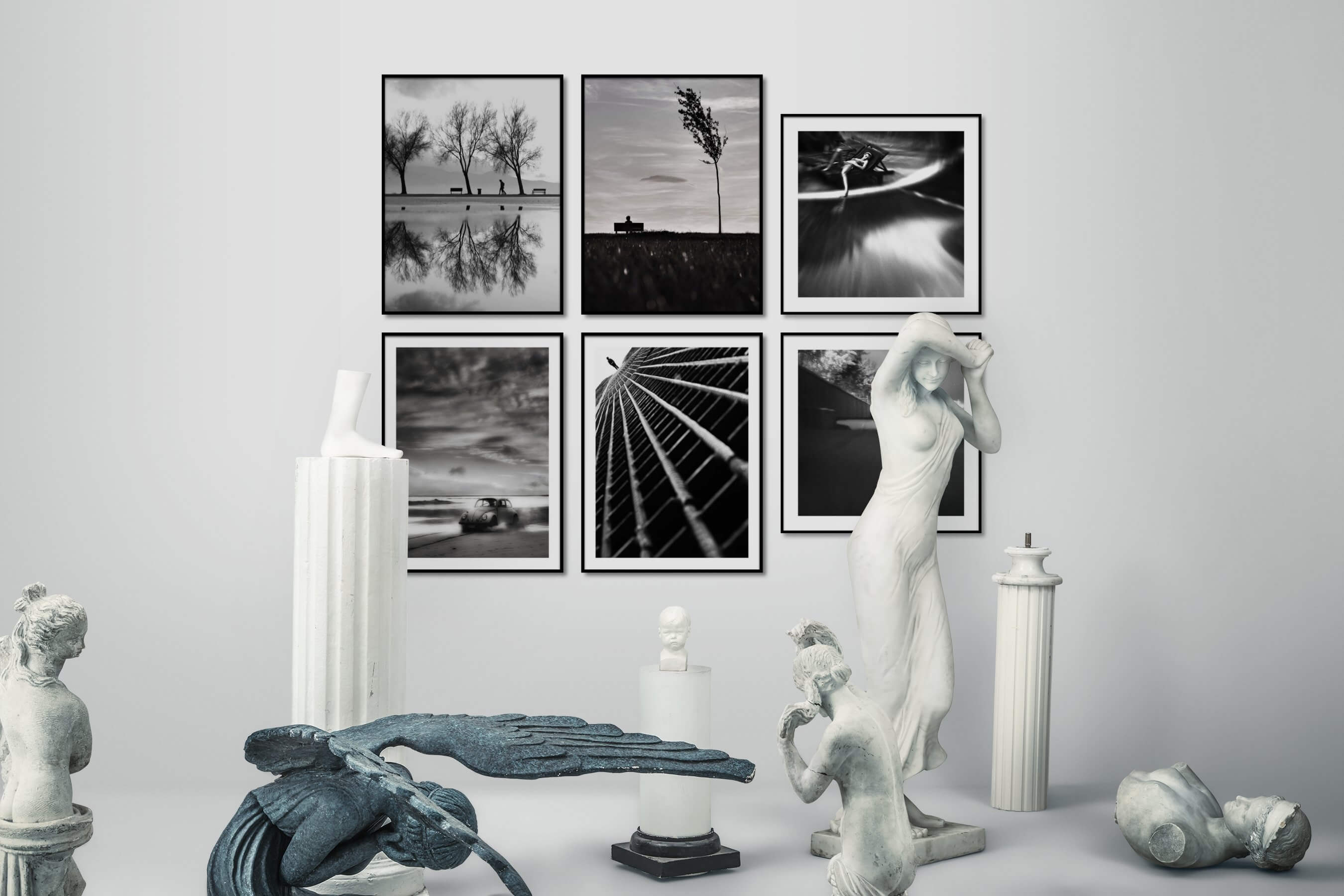 Gallery wall idea with six framed pictures arranged on a wall depicting Black & White, Nature, Country Life, Beach & Water, Vintage, For the Moderate, Artsy, and City Life
