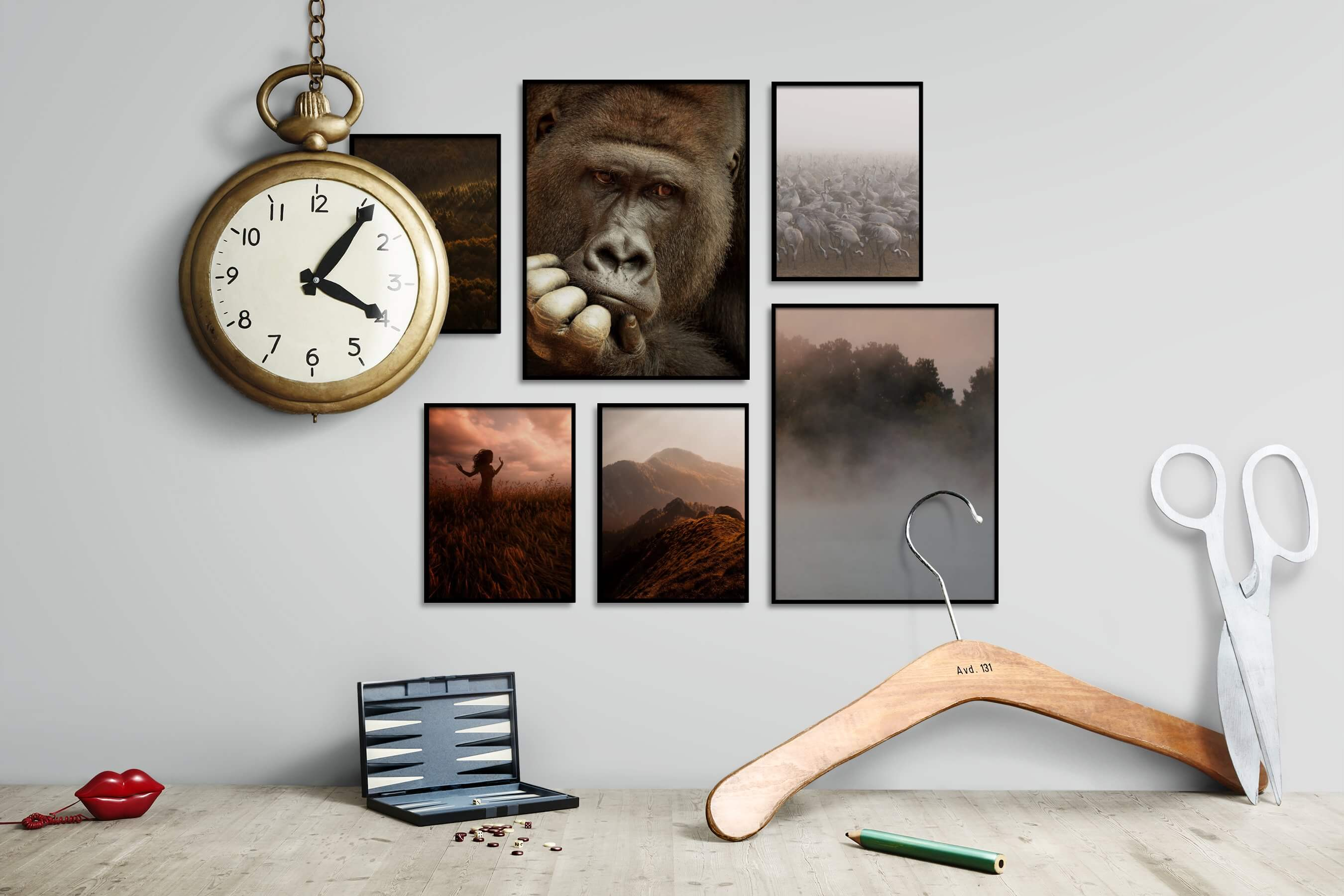 Gallery wall idea with six framed pictures arranged on a wall depicting For the Moderate, Nature, Mindfulness, Animals, and Country Life