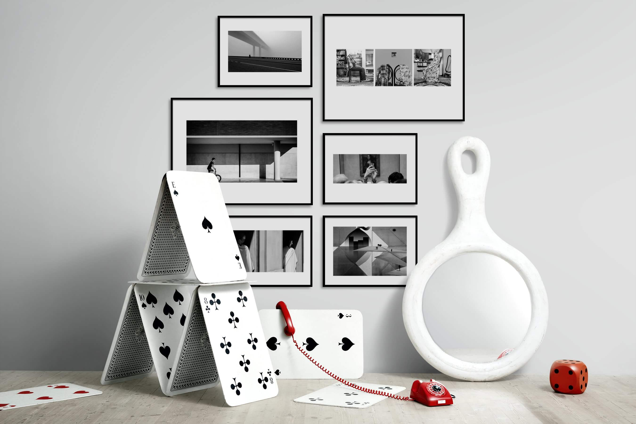 Gallery wall idea with six framed pictures arranged on a wall depicting Black & White, For the Minimalist, Artsy, For the Moderate, and City Life