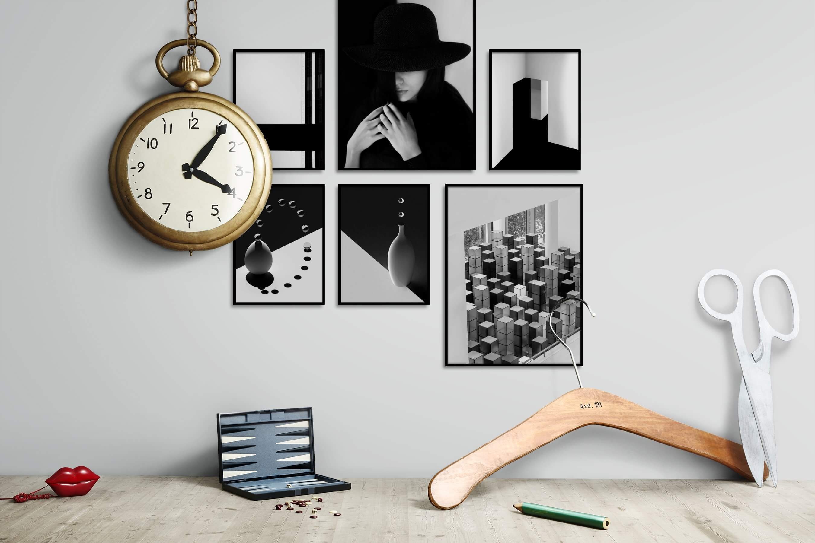 Gallery wall idea with six framed pictures arranged on a wall depicting Black & White, For the Minimalist, City Life, Fashion & Beauty, For the Moderate, and Dark Tones