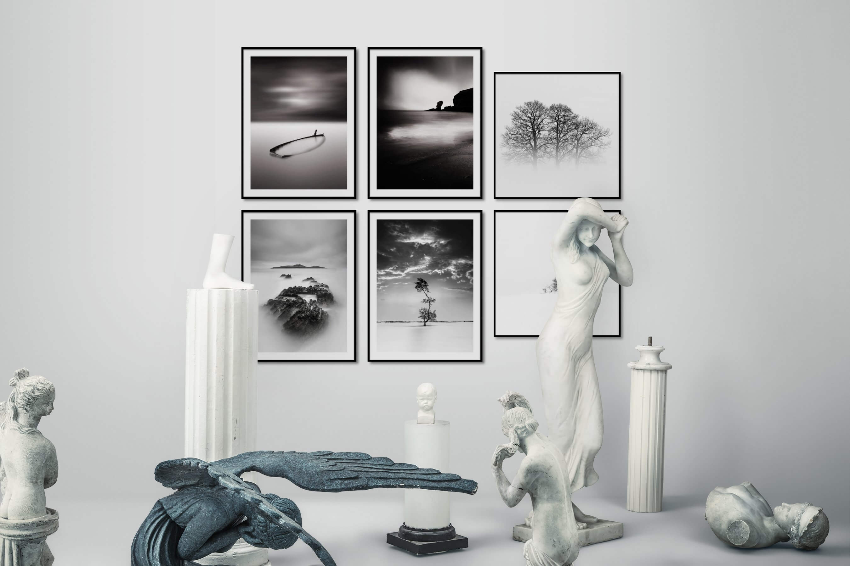 Gallery wall idea with six framed pictures arranged on a wall depicting For the Minimalist, Beach & Water, Mindfulness, Black & White, Bright Tones, Nature, and Country Life