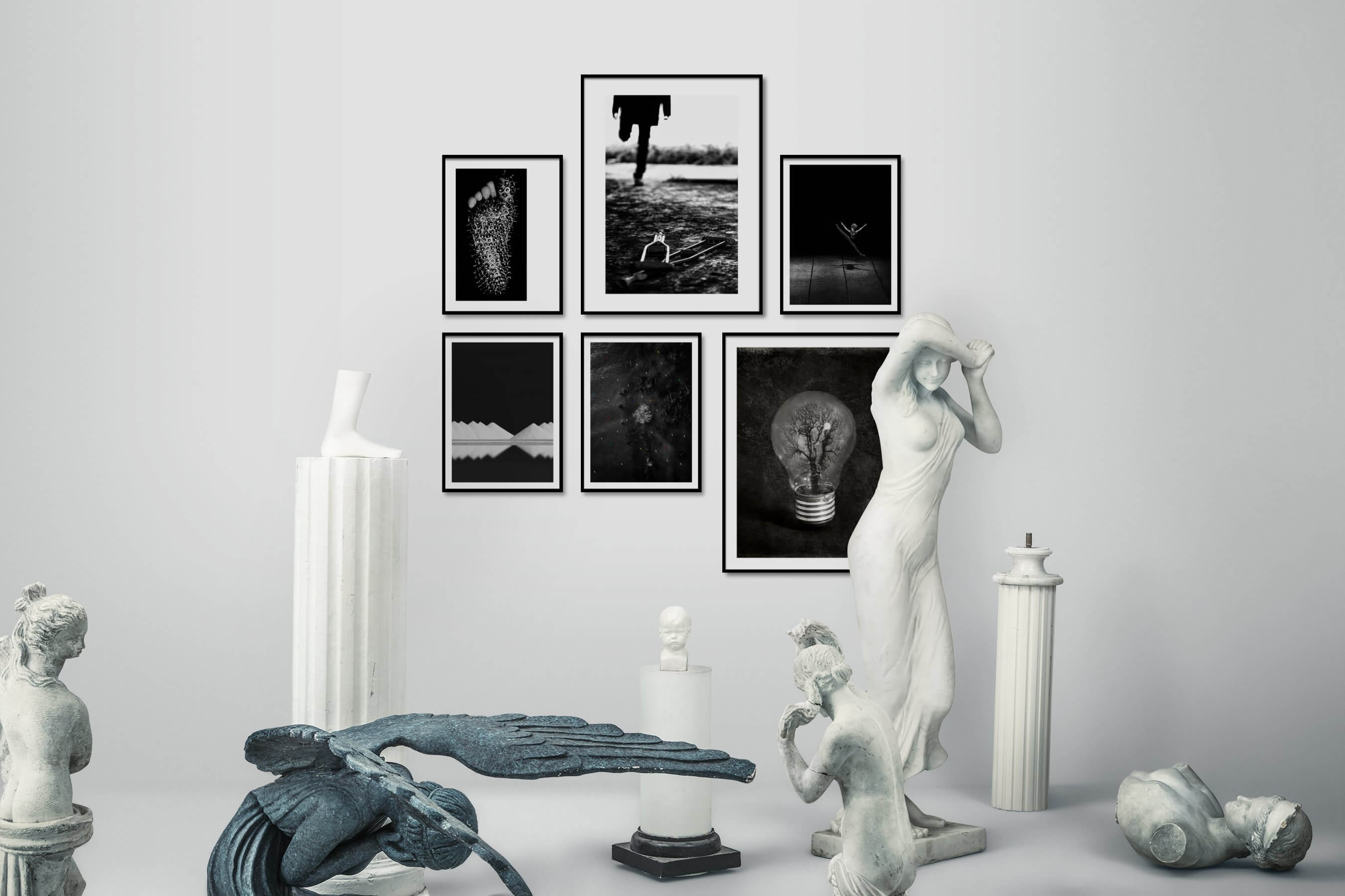Gallery wall idea with six framed pictures arranged on a wall depicting Artsy, Black & White, For the Minimalist, Nature, For the Moderate, and Fashion & Beauty