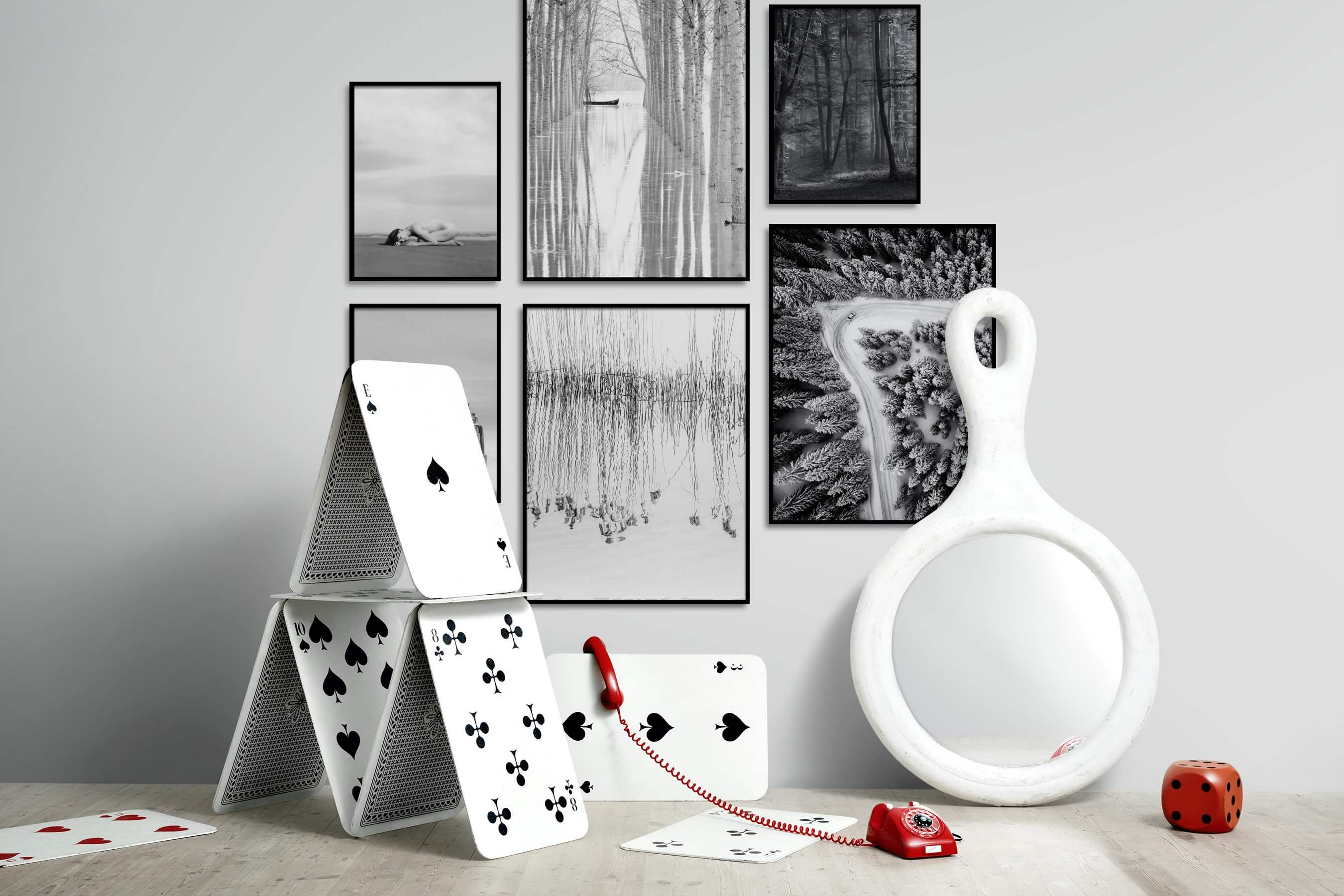 Gallery wall idea with six framed pictures arranged on a wall depicting Fashion & Beauty, Black & White, For the Minimalist, Beach & Water, Nature, Mindfulness, and For the Moderate