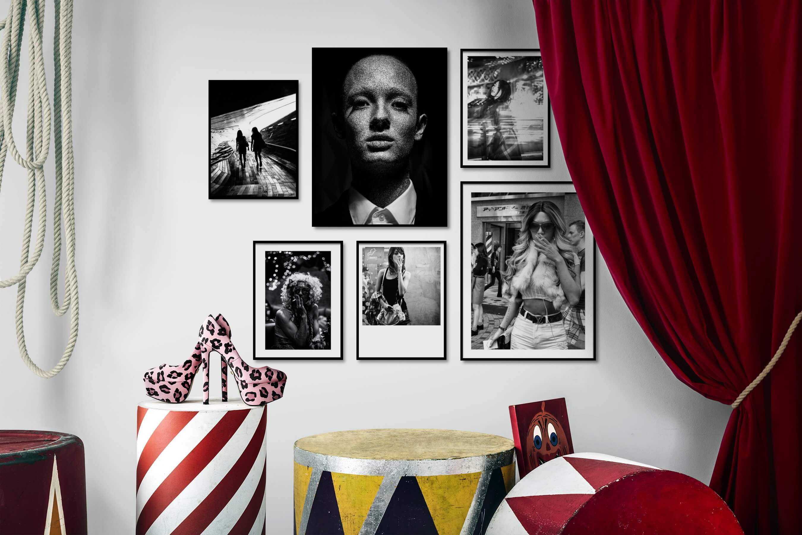 Gallery wall idea with six framed pictures arranged on a wall depicting Black & White, City Life, Fashion & Beauty, and Dark Tones