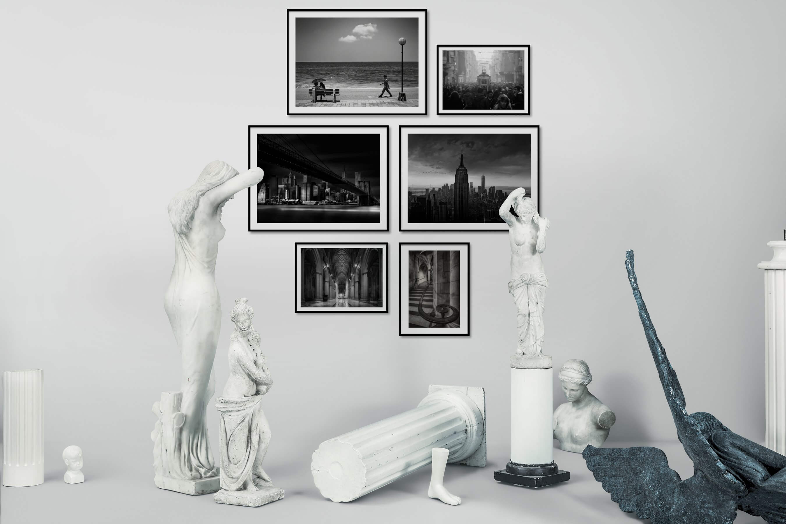 Gallery wall idea with six framed pictures arranged on a wall depicting Black & White, Beach & Water, City Life, Americana, For the Maximalist, and For the Moderate