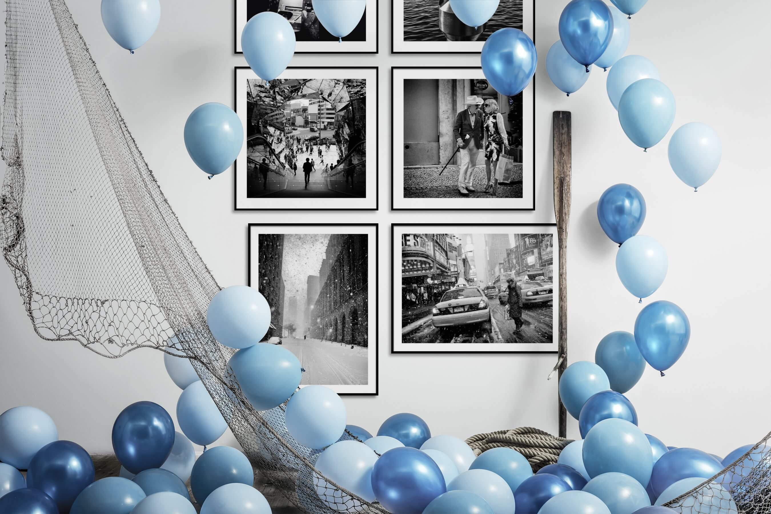 Gallery wall idea with six framed pictures arranged on a wall depicting Black & White, Vintage, Beach & Water, City Life, Fashion & Beauty, and Americana