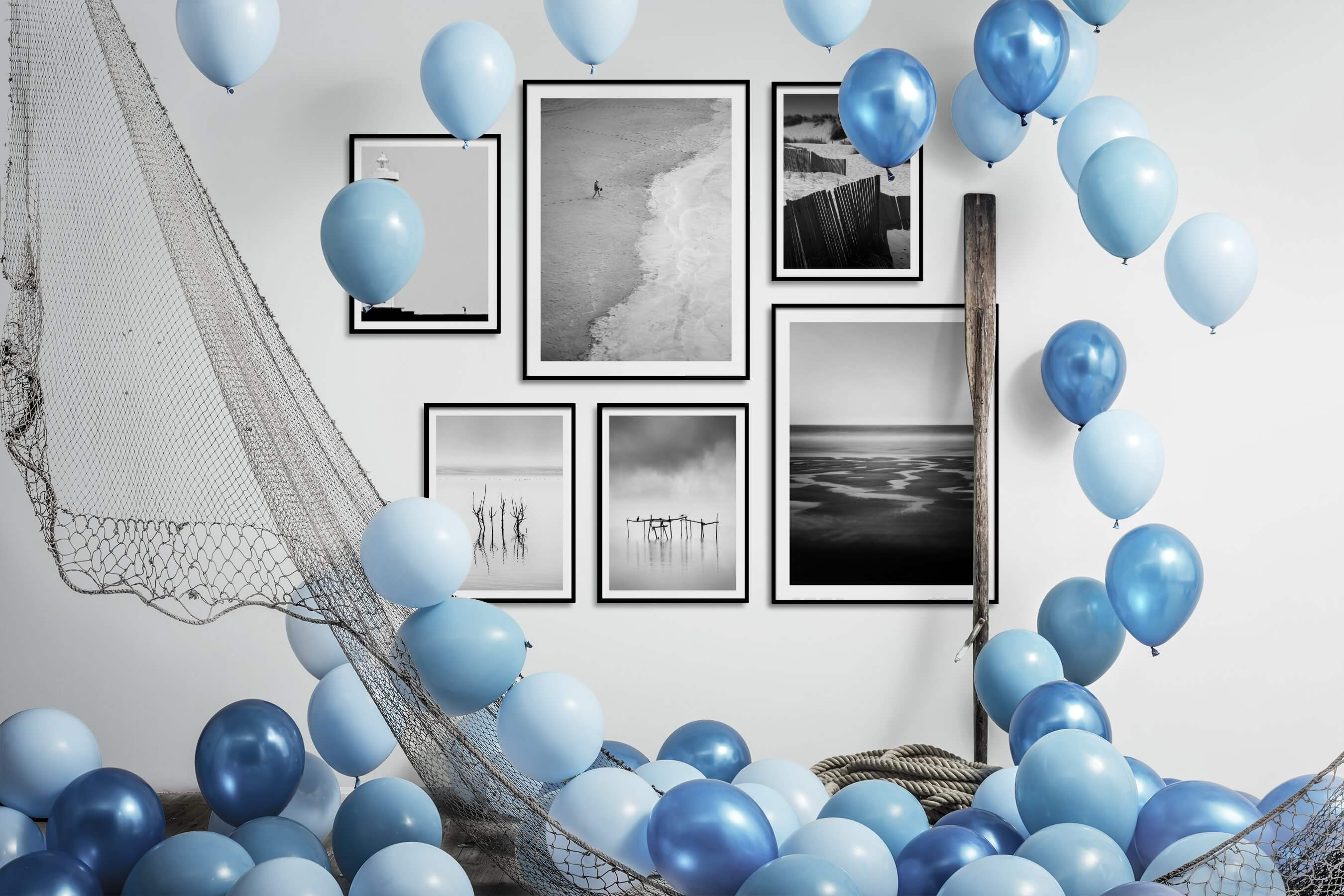 Gallery wall idea with six framed pictures arranged on a wall depicting Black & White, For the Minimalist, Beach & Water, and Mindfulness