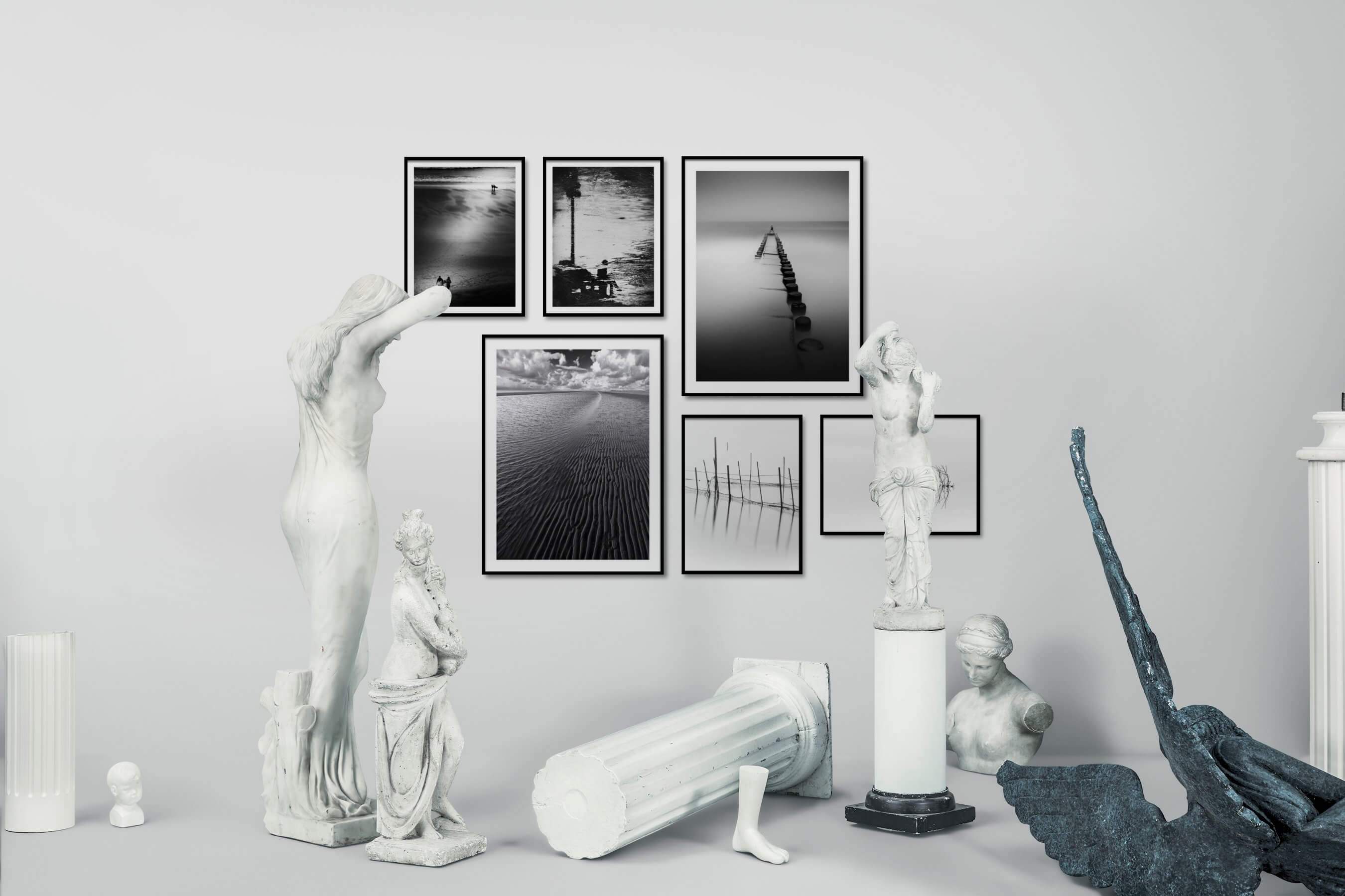 Gallery wall idea with six framed pictures arranged on a wall depicting Black & White, Beach & Water, For the Moderate, City Life, For the Minimalist, Mindfulness, Bright Tones, and Nature