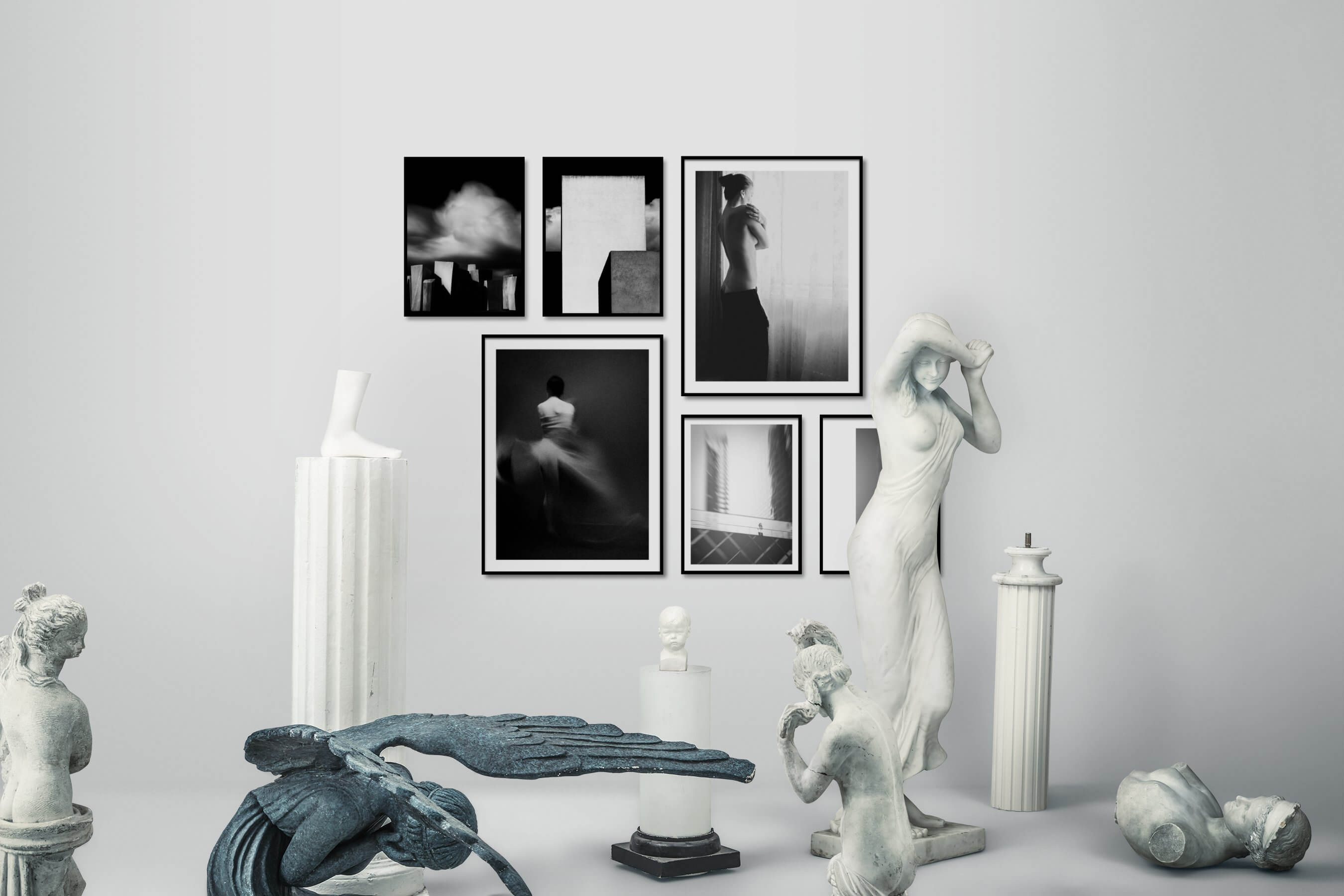 Gallery wall idea with six framed pictures arranged on a wall depicting Black & White, Dark Tones, For the Moderate, For the Minimalist, Fashion & Beauty, and City Life