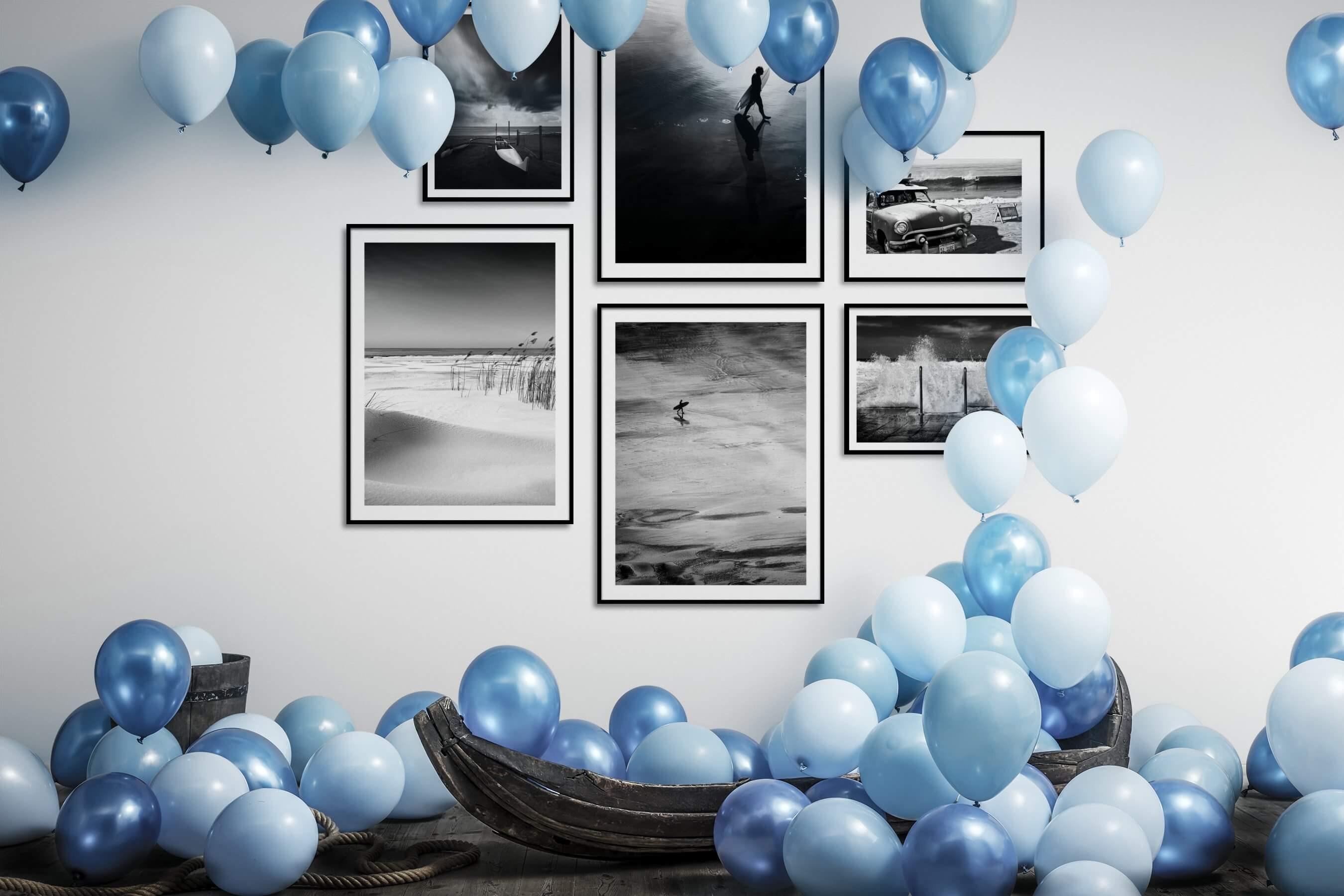 Gallery wall idea with six framed pictures arranged on a wall depicting Black & White, Beach & Water, For the Minimalist, Americana, and Vintage
