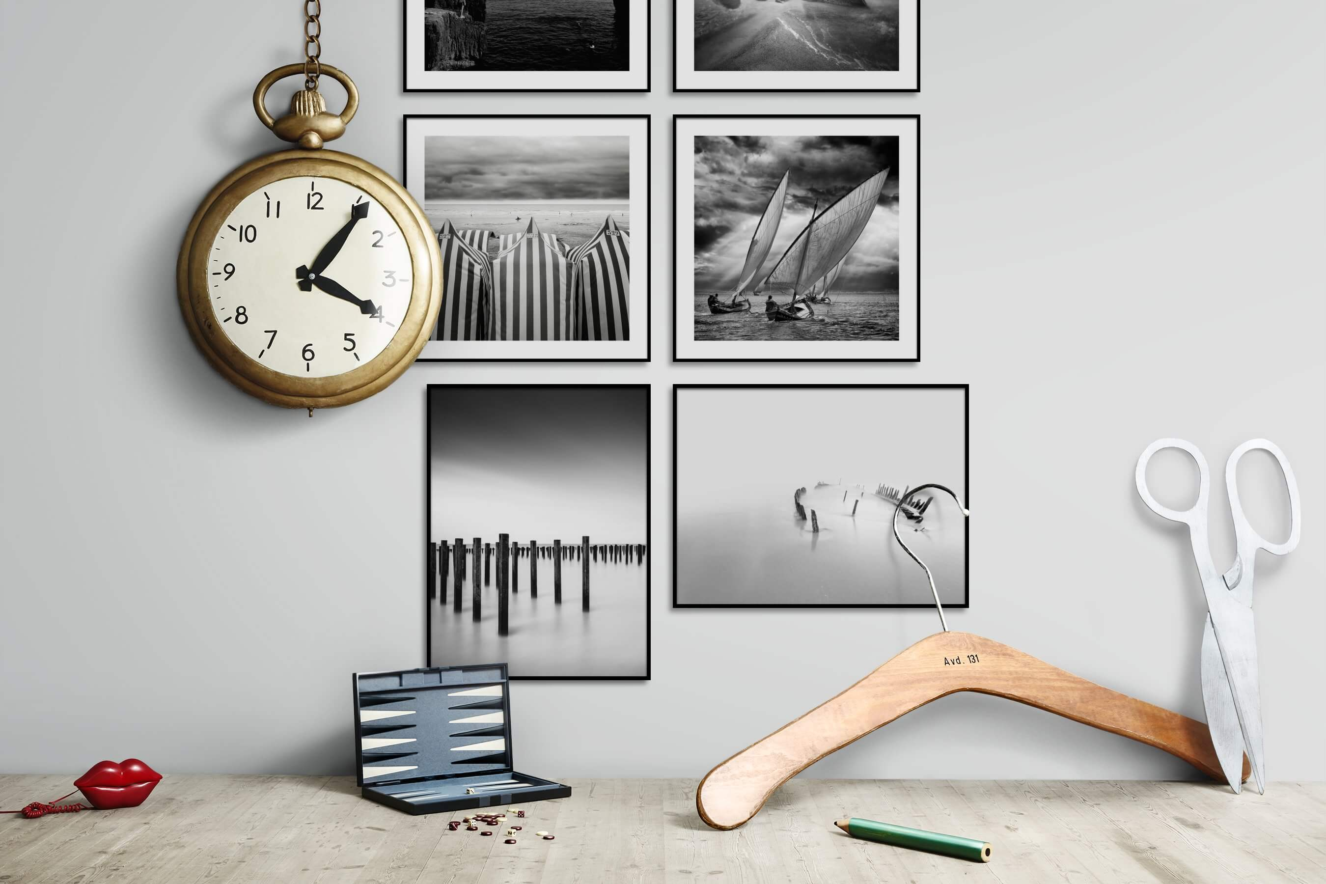 Gallery wall idea with six framed pictures arranged on a wall depicting Black & White, Beach & Water, Mindfulness, For the Moderate, and For the Minimalist