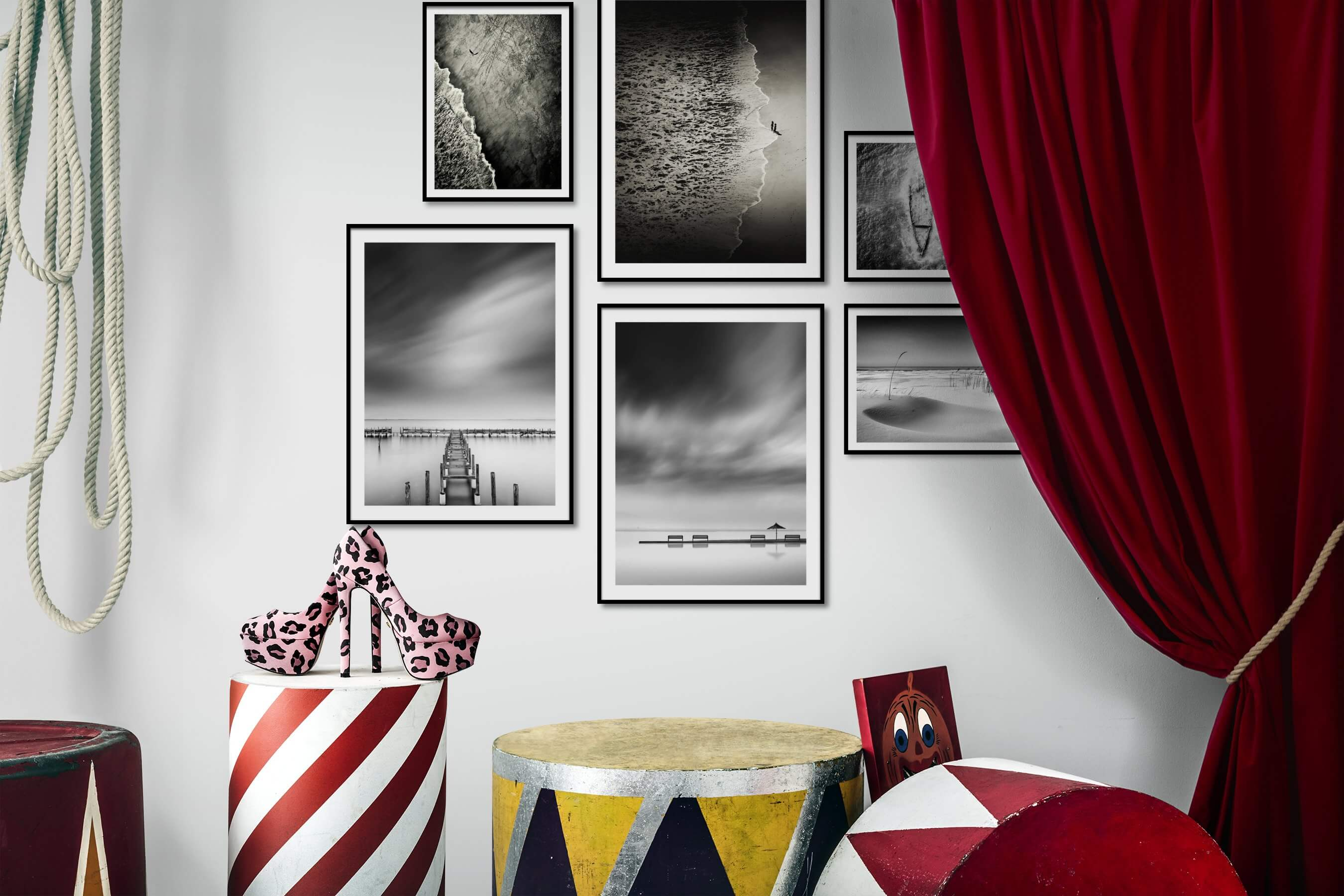 Gallery wall idea with six framed pictures arranged on a wall depicting Black & White, For the Moderate, Beach & Water, and Mindfulness