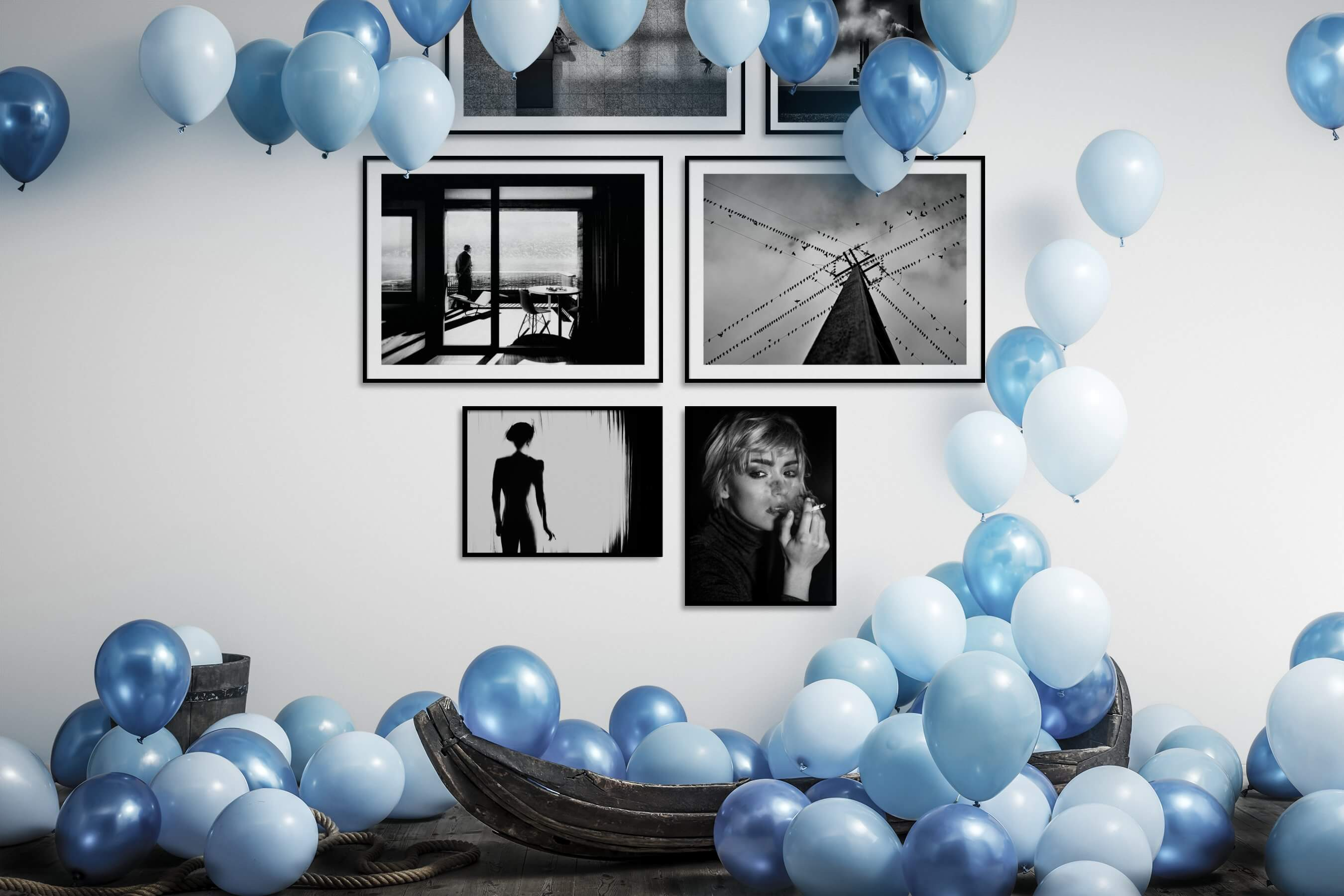 Gallery wall idea with six framed pictures arranged on a wall depicting Black & White, City Life, For the Moderate, Artsy, and Fashion & Beauty