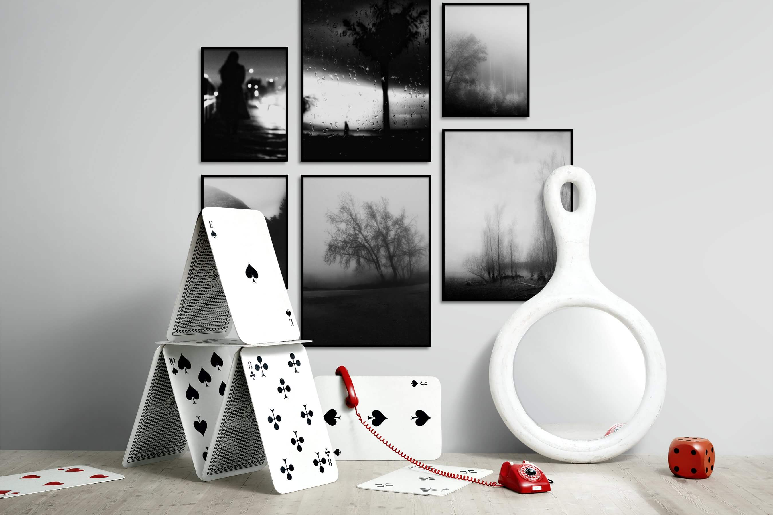Gallery wall idea with six framed pictures arranged on a wall depicting Black & White, City Life, Country Life, and Nature
