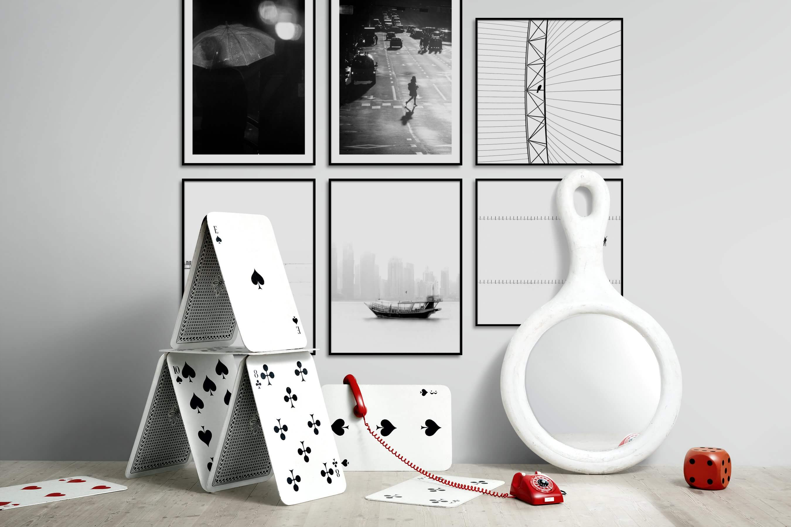 Gallery wall idea with six framed pictures arranged on a wall depicting Black & White, For the Minimalist, City Life, Bright Tones, and For the Moderate