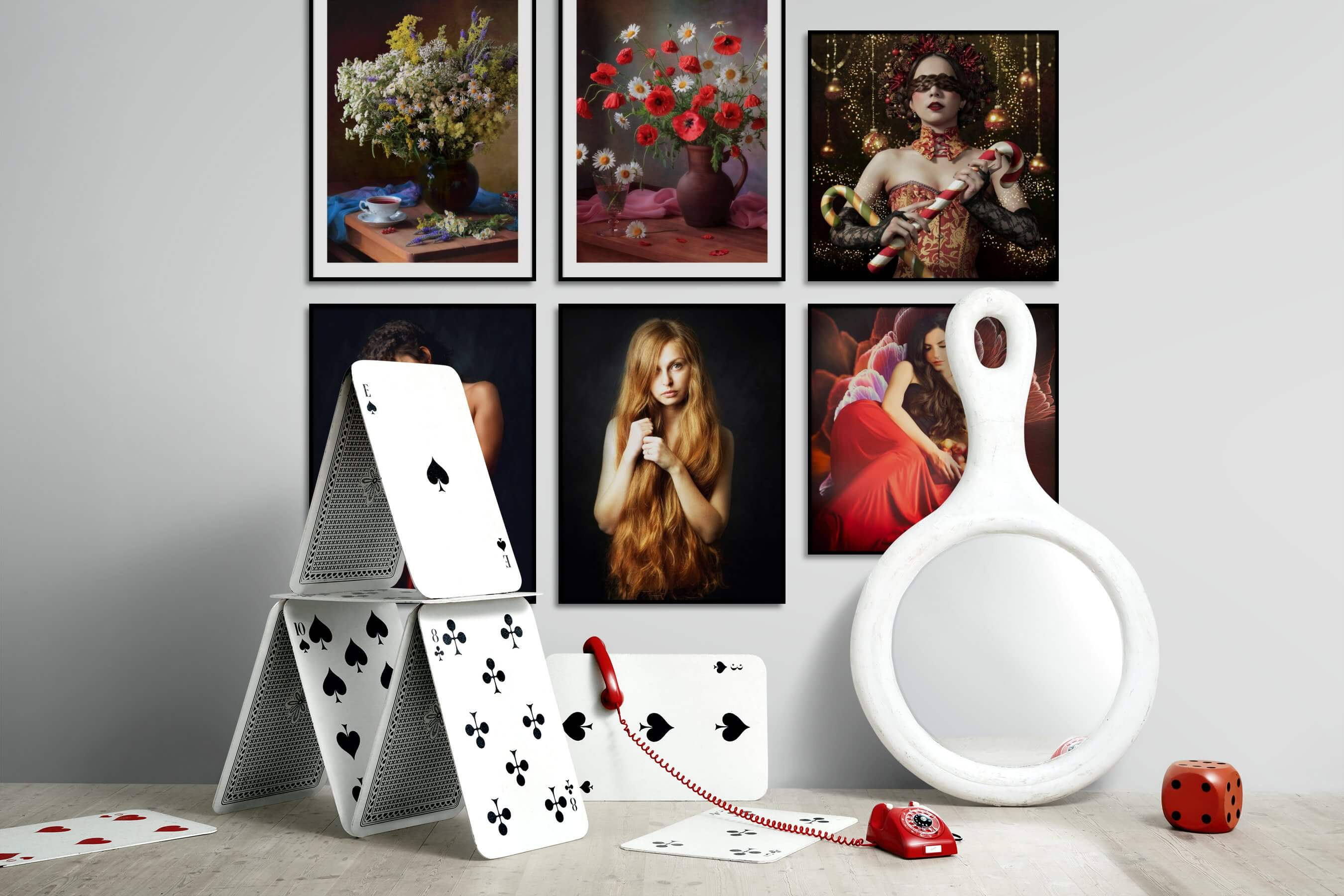 Gallery wall idea with six framed pictures arranged on a wall depicting Flowers & Plants, Vintage, Fashion & Beauty, Dark Tones, and Artsy