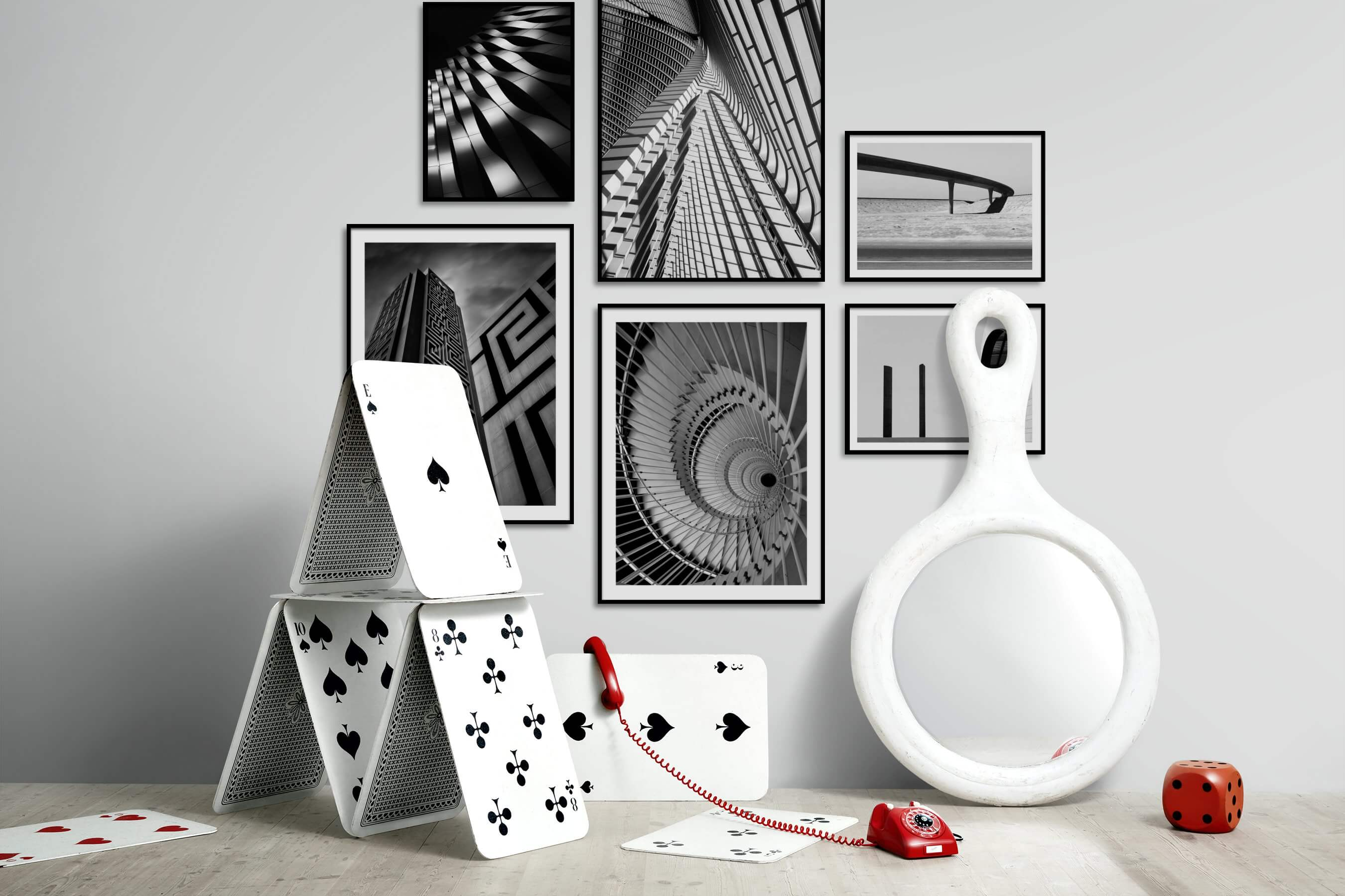 Gallery wall idea with six framed pictures arranged on a wall depicting Black & White, For the Moderate, For the Maximalist, City Life, Country Life, and For the Minimalist