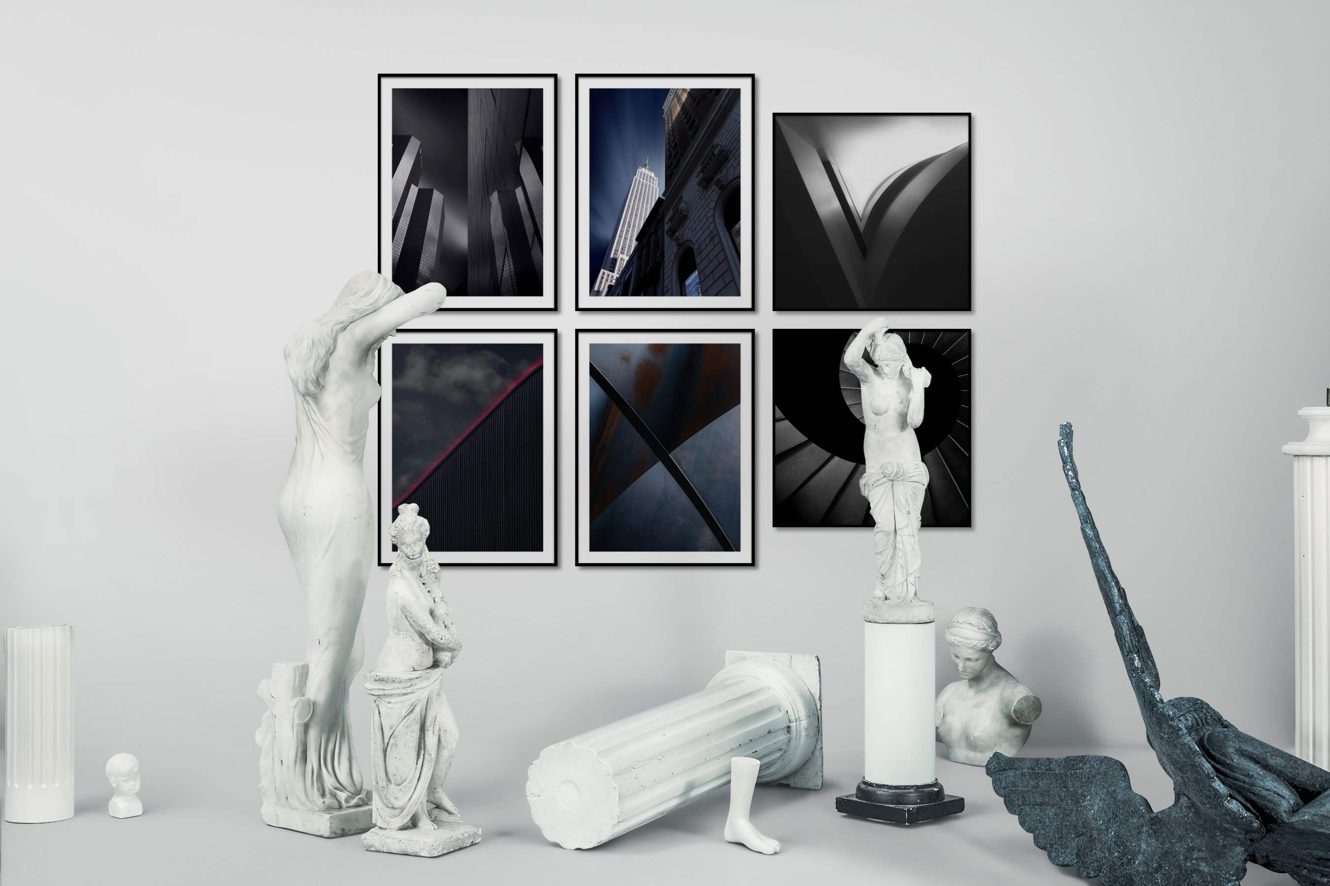 Gallery wall idea with six framed pictures arranged on a wall depicting Black & White, For the Moderate, City Life, Americana, and For the Minimalist