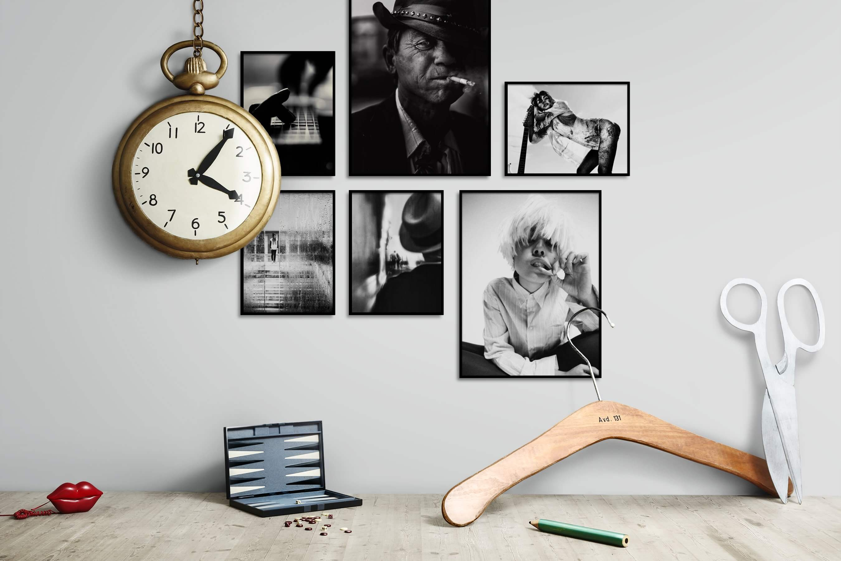 Gallery wall idea with six framed pictures arranged on a wall depicting Black & White, For the Moderate, Fashion & Beauty, and Vintage