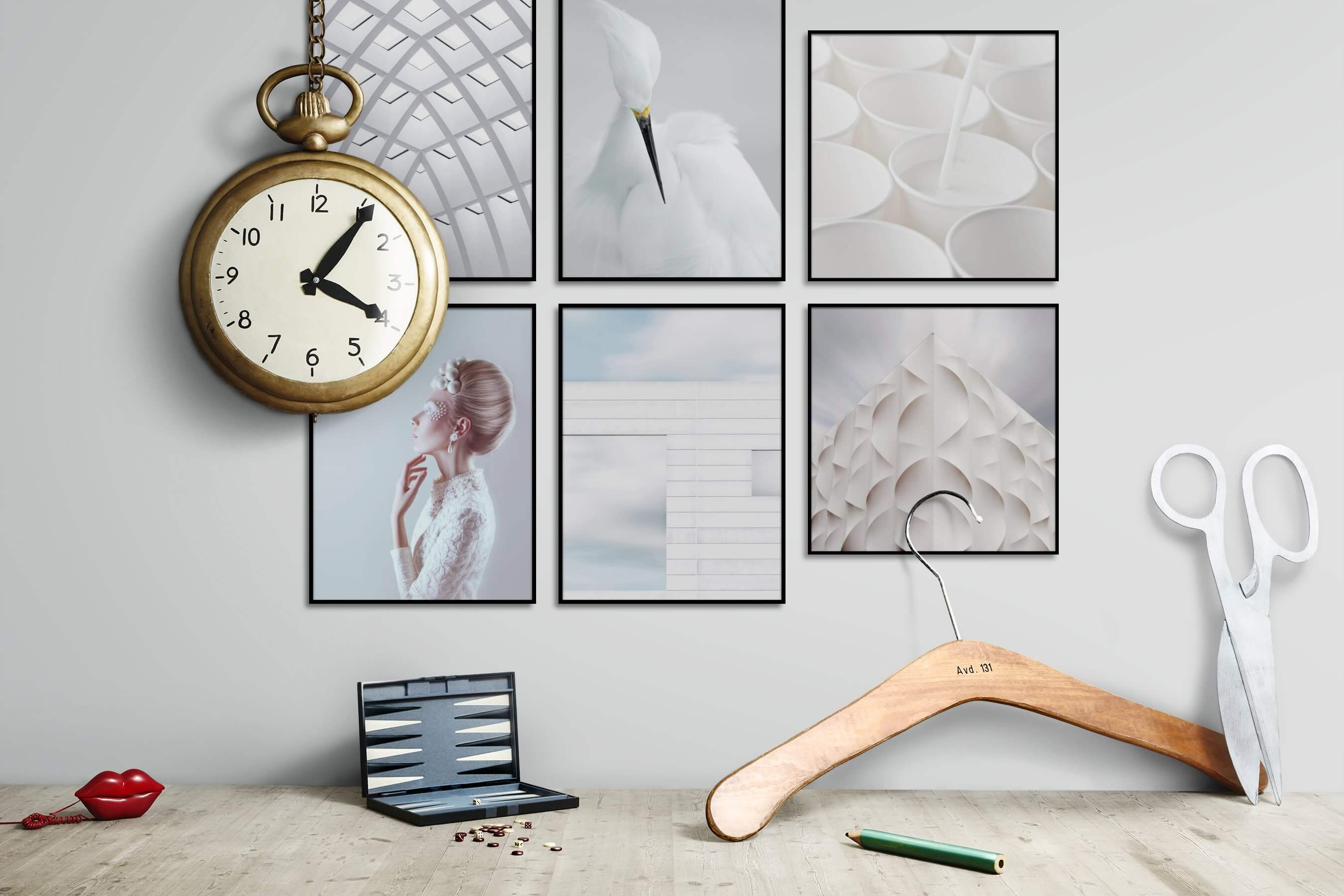 Gallery wall idea with six framed pictures arranged on a wall depicting Black & White, For the Moderate, For the Minimalist, Animals, and Fashion & Beauty