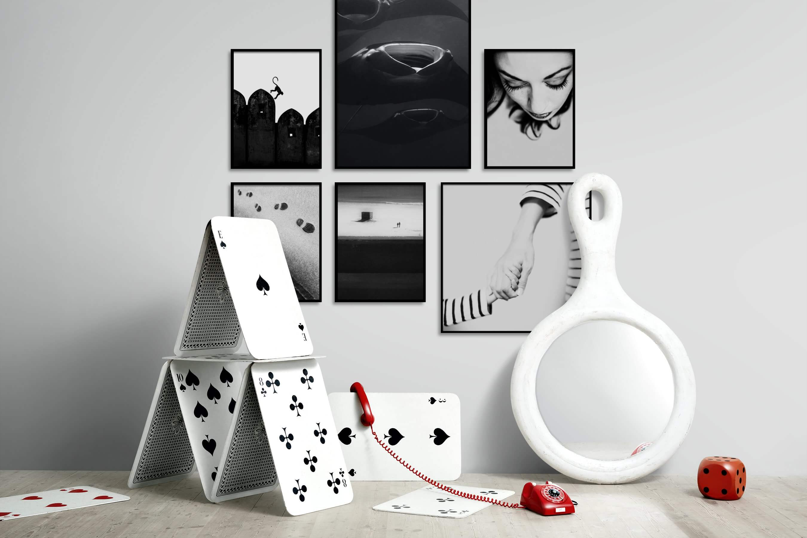 Gallery wall idea with six framed pictures arranged on a wall depicting Black & White, Animals, For the Moderate, Beach & Water, and Fashion & Beauty