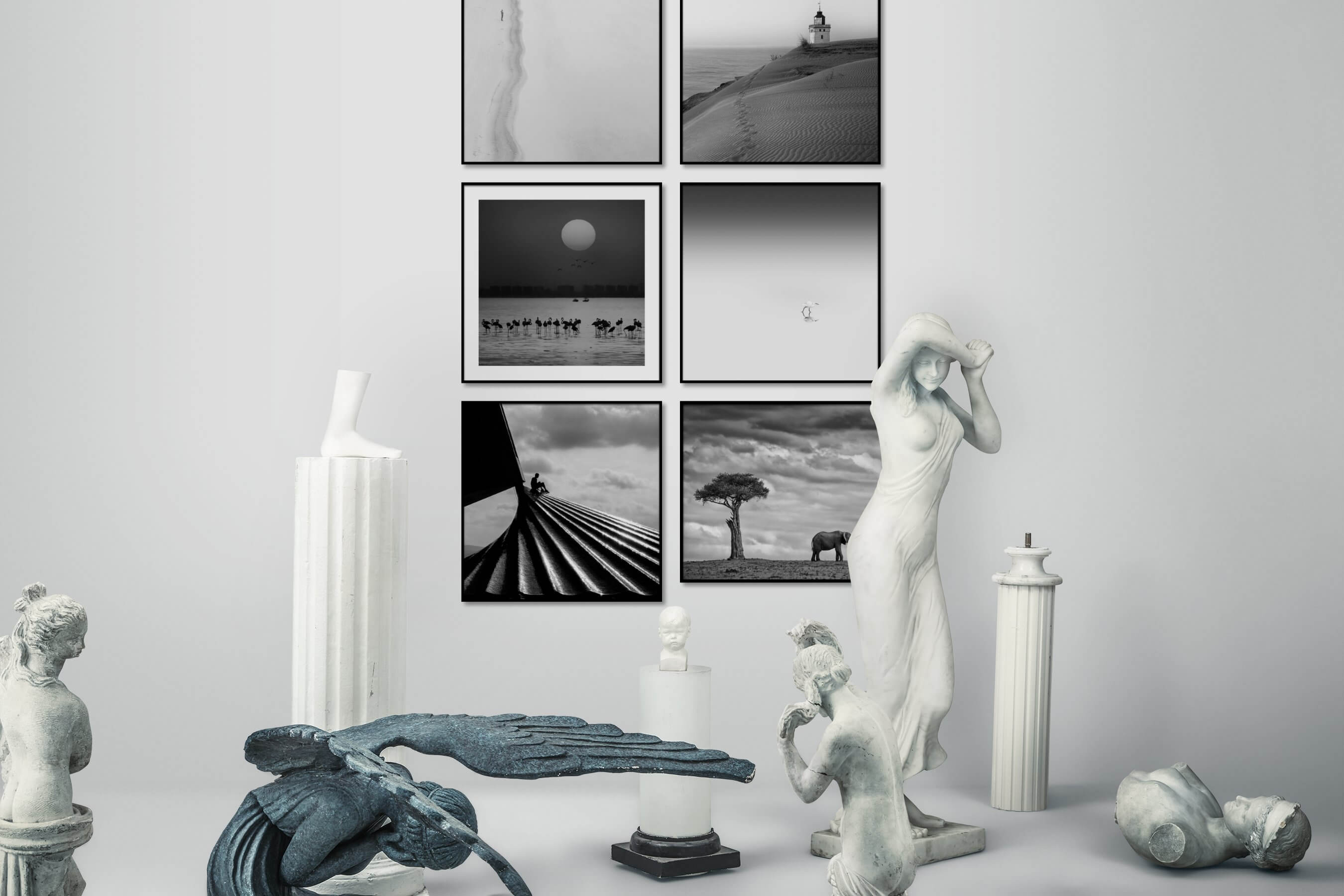 Gallery wall idea with six framed pictures arranged on a wall depicting Black & White, Beach & Water, Mindfulness, Animals, For the Minimalist, and For the Moderate