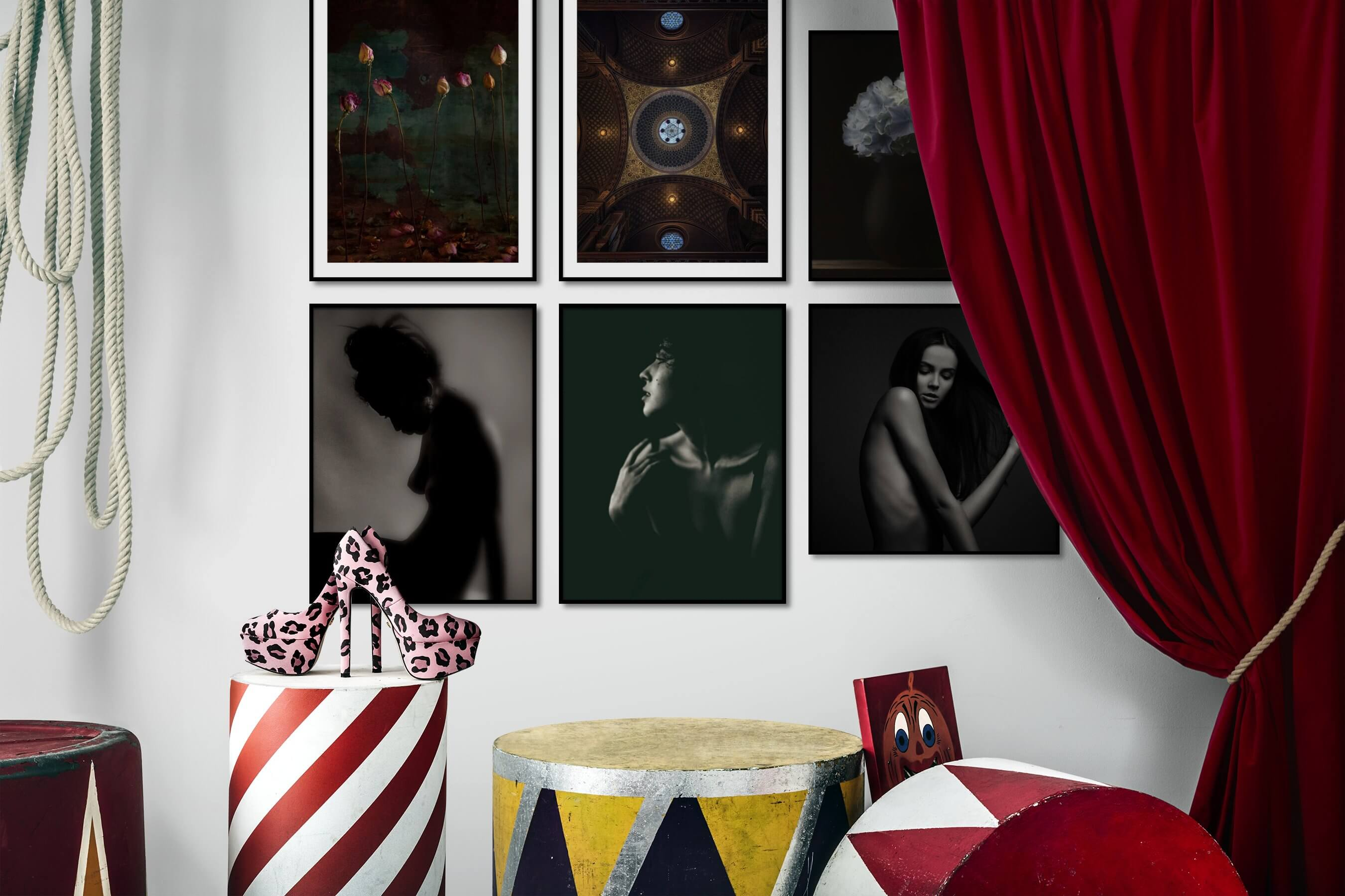Gallery wall idea with six framed pictures arranged on a wall depicting Flowers & Plants, Vintage, For the Maximalist, Fashion & Beauty, Black & White, Bold, Dark Tones, and For the Minimalist