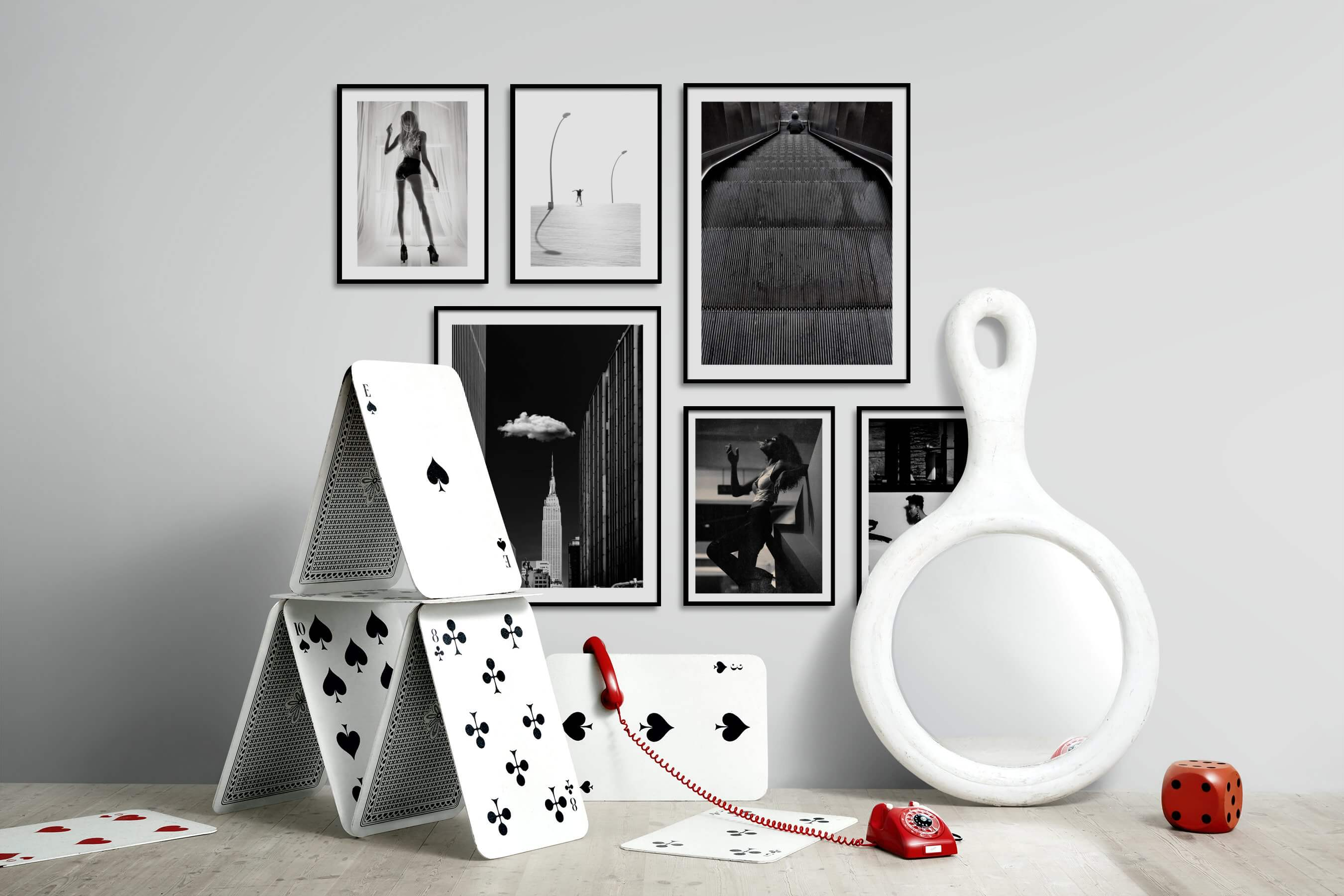 Gallery wall idea with six framed pictures arranged on a wall depicting Fashion & Beauty, Black & White, Bright Tones, For the Moderate, City Life, Americana, and Vintage