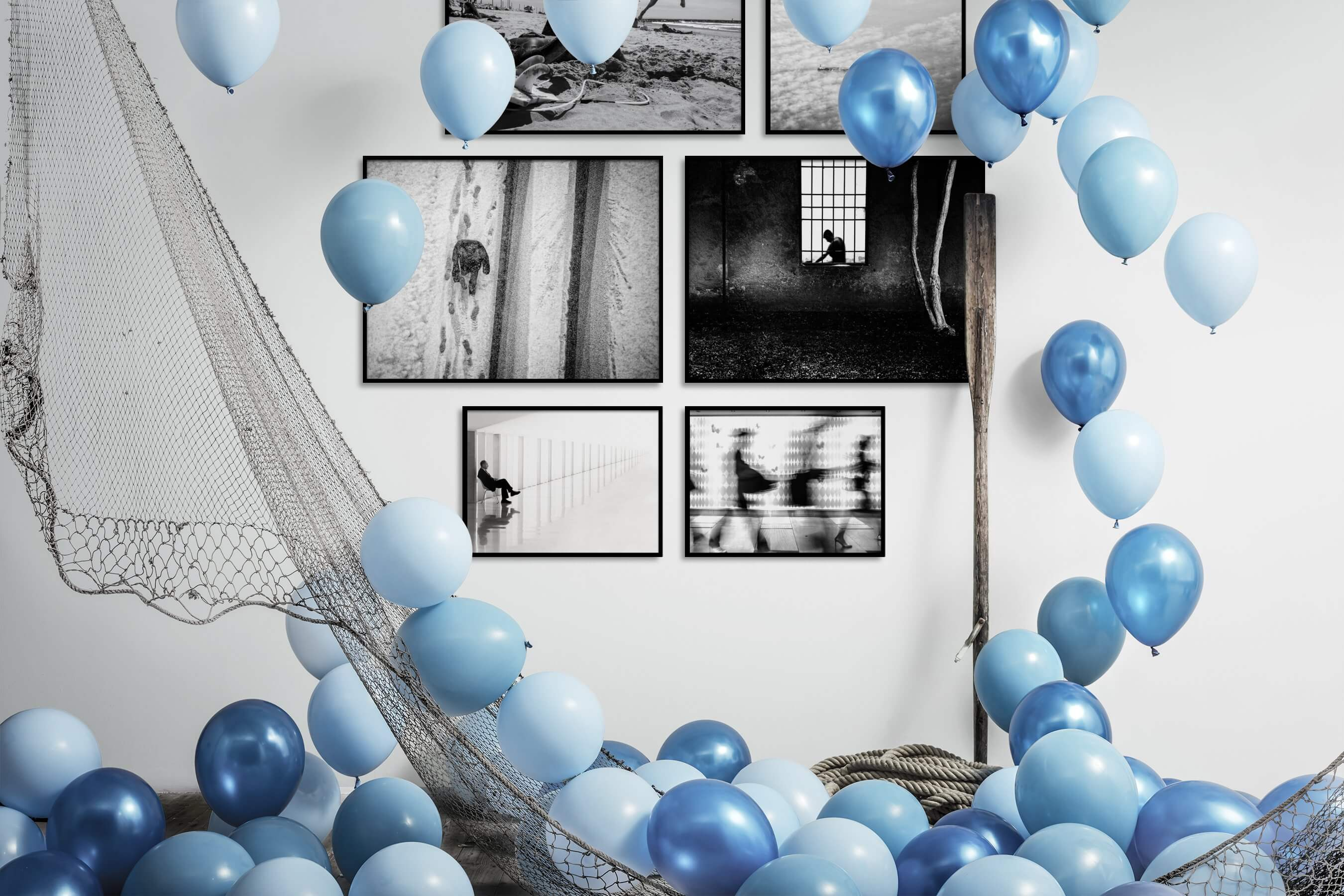 Gallery wall idea with six framed pictures arranged on a wall depicting Black & White, Animals, Beach & Water, For the Moderate, For the Minimalist, and City Life