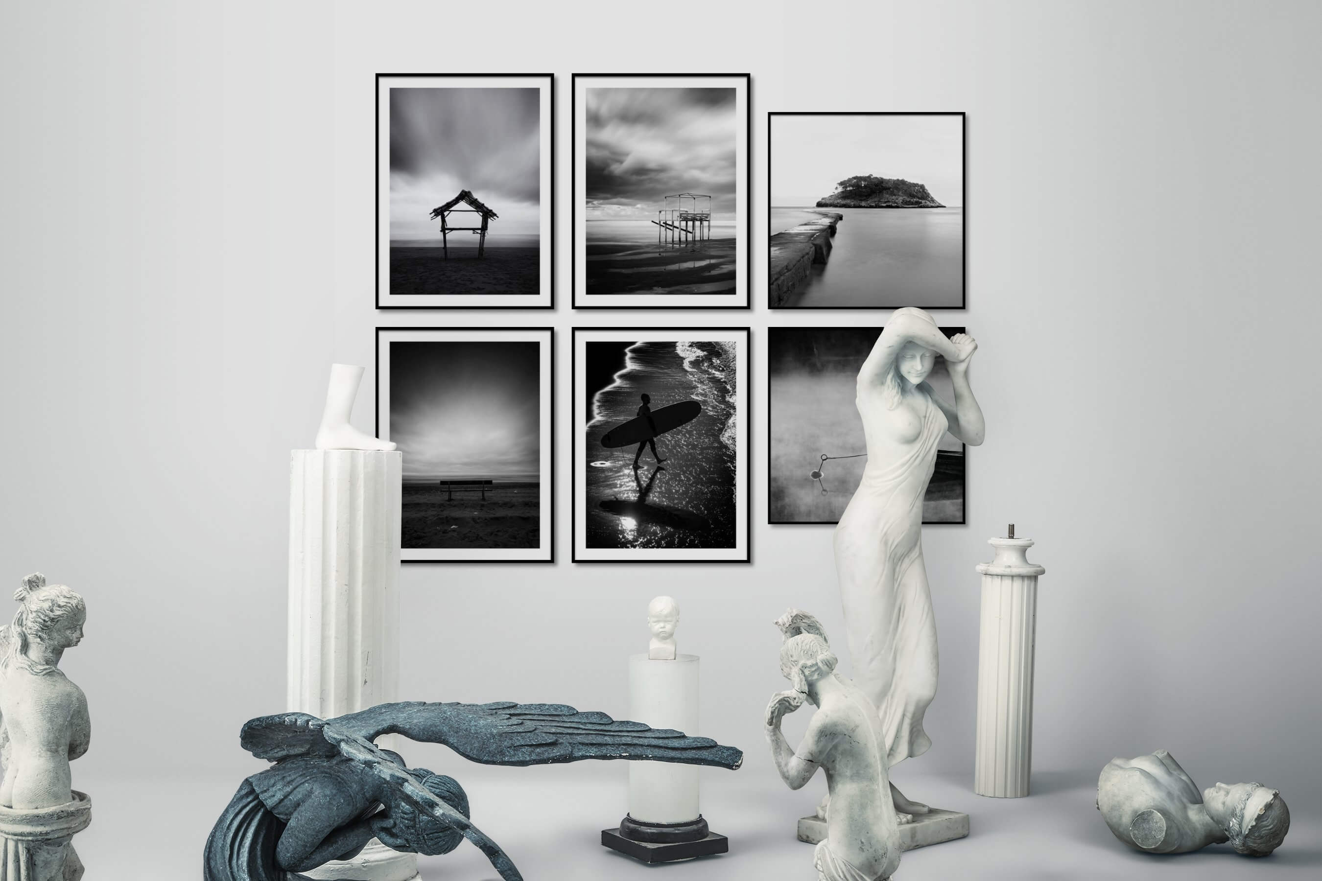 Gallery wall idea with six framed pictures arranged on a wall depicting Black & White, For the Minimalist, Beach & Water, Mindfulness, and For the Moderate