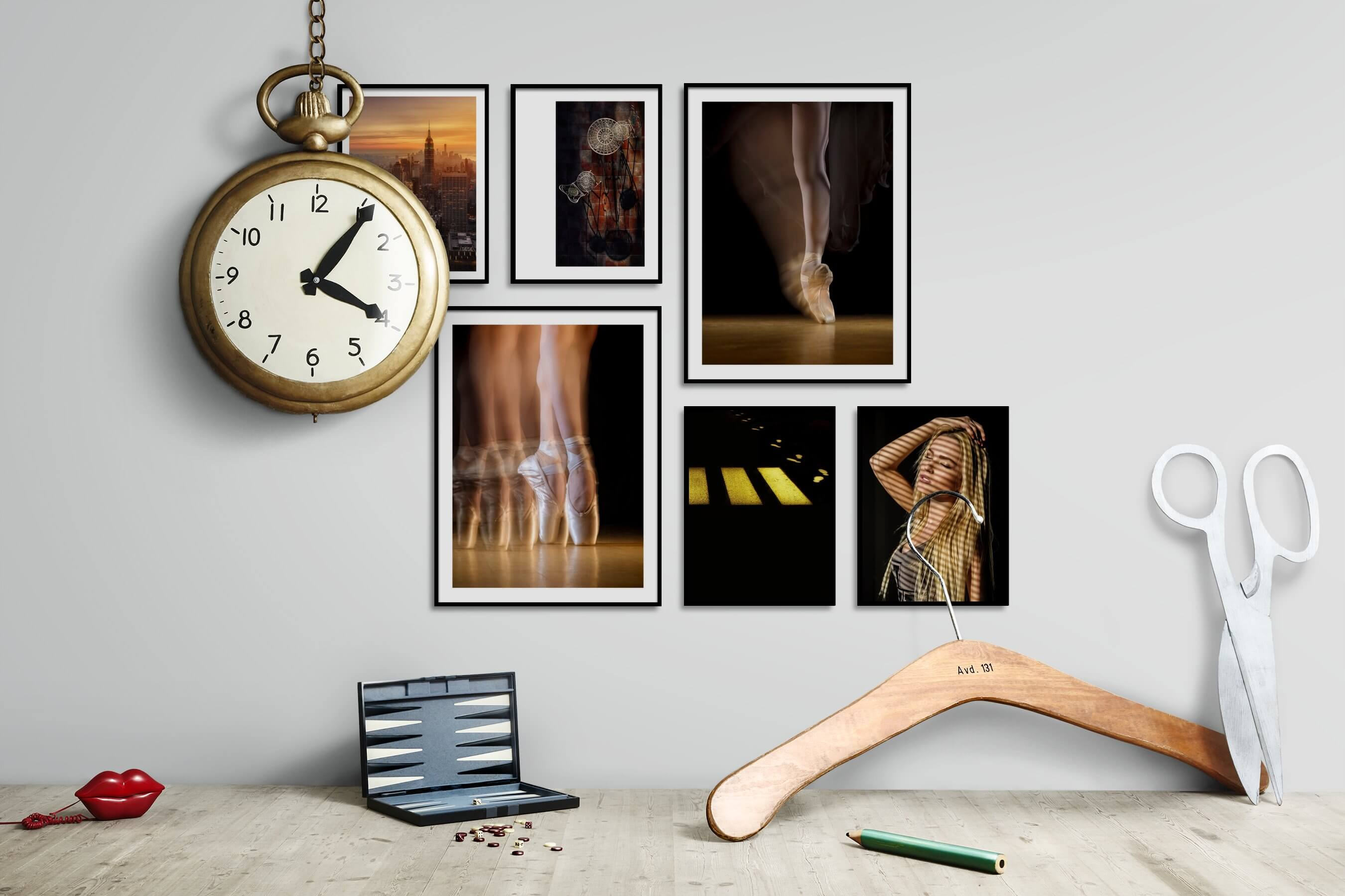 Gallery wall idea with six framed pictures arranged on a wall depicting City Life, Americana, For the Moderate, Fashion & Beauty, Dark Tones, and For the Minimalist