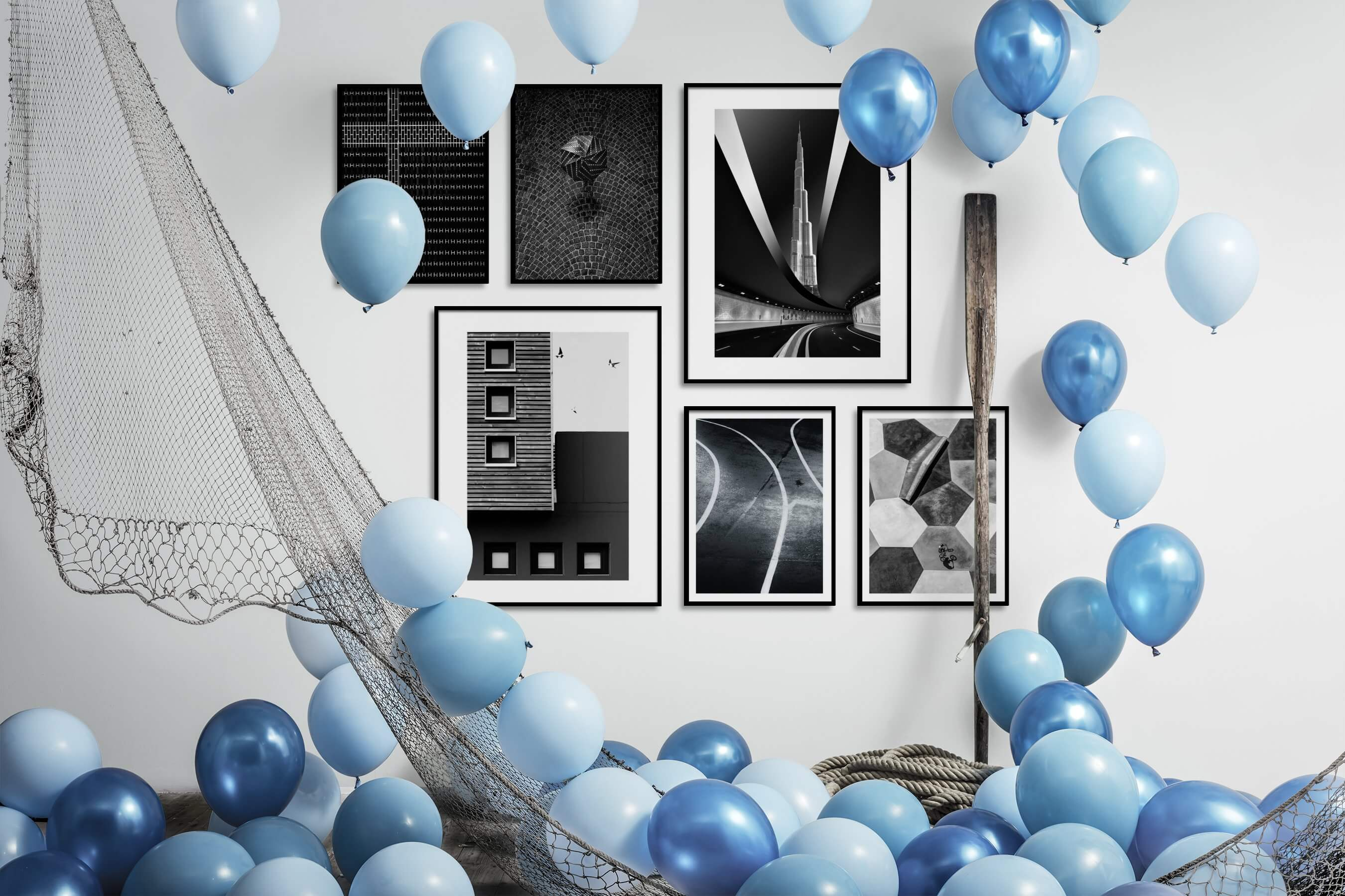 Gallery wall idea with six framed pictures arranged on a wall depicting Black & White, For the Maximalist, For the Minimalist, City Life, and For the Moderate