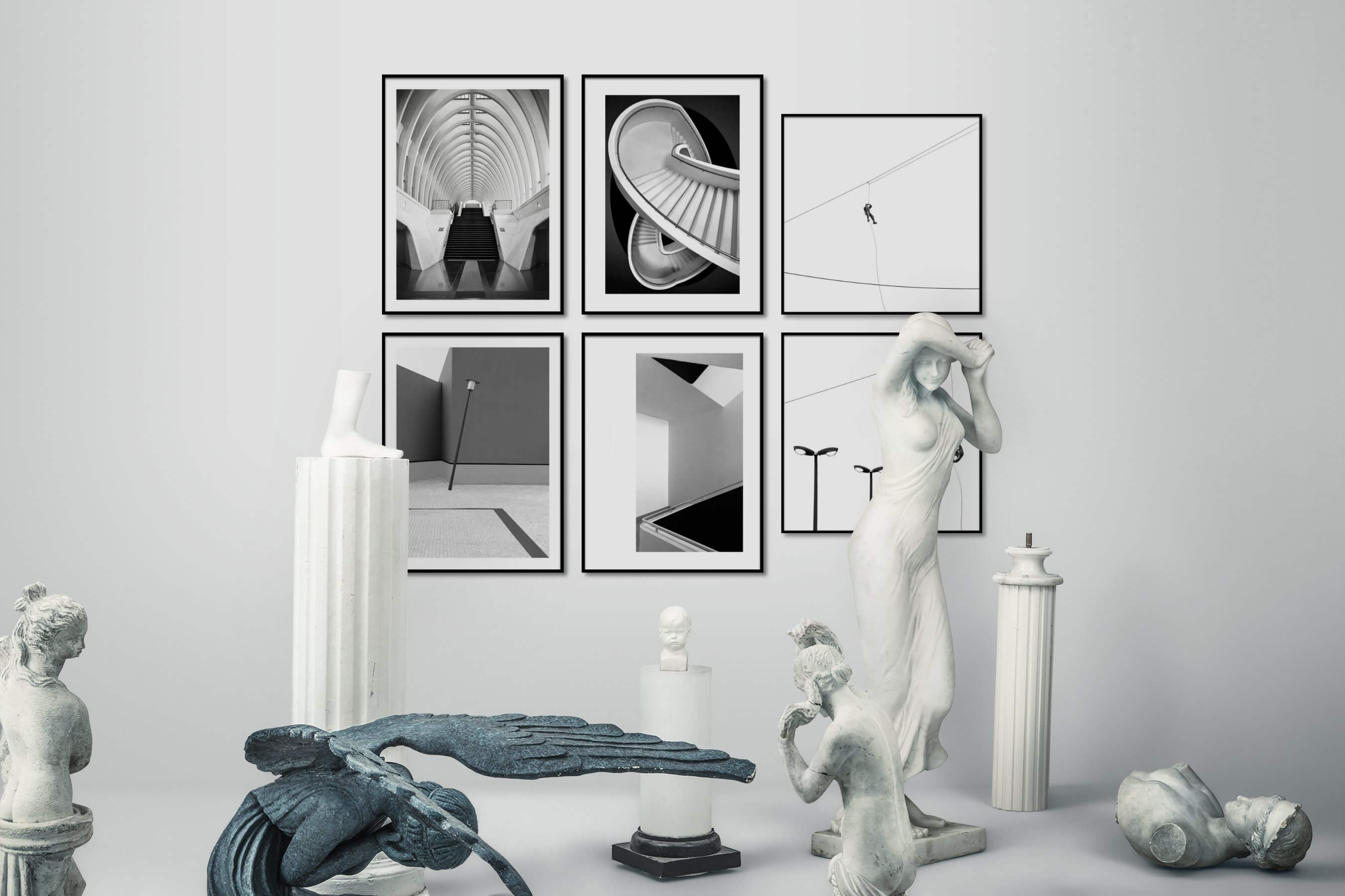 Gallery wall idea with six framed pictures arranged on a wall depicting Black & White, For the Moderate, City Life, For the Minimalist, and Bright Tones