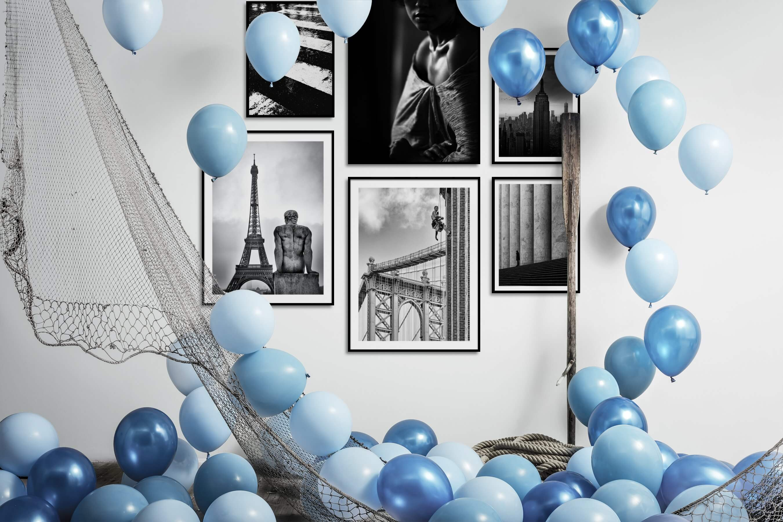 Gallery wall idea with six framed pictures arranged on a wall depicting Black & White, For the Moderate, City Life, Fashion & Beauty, and Americana