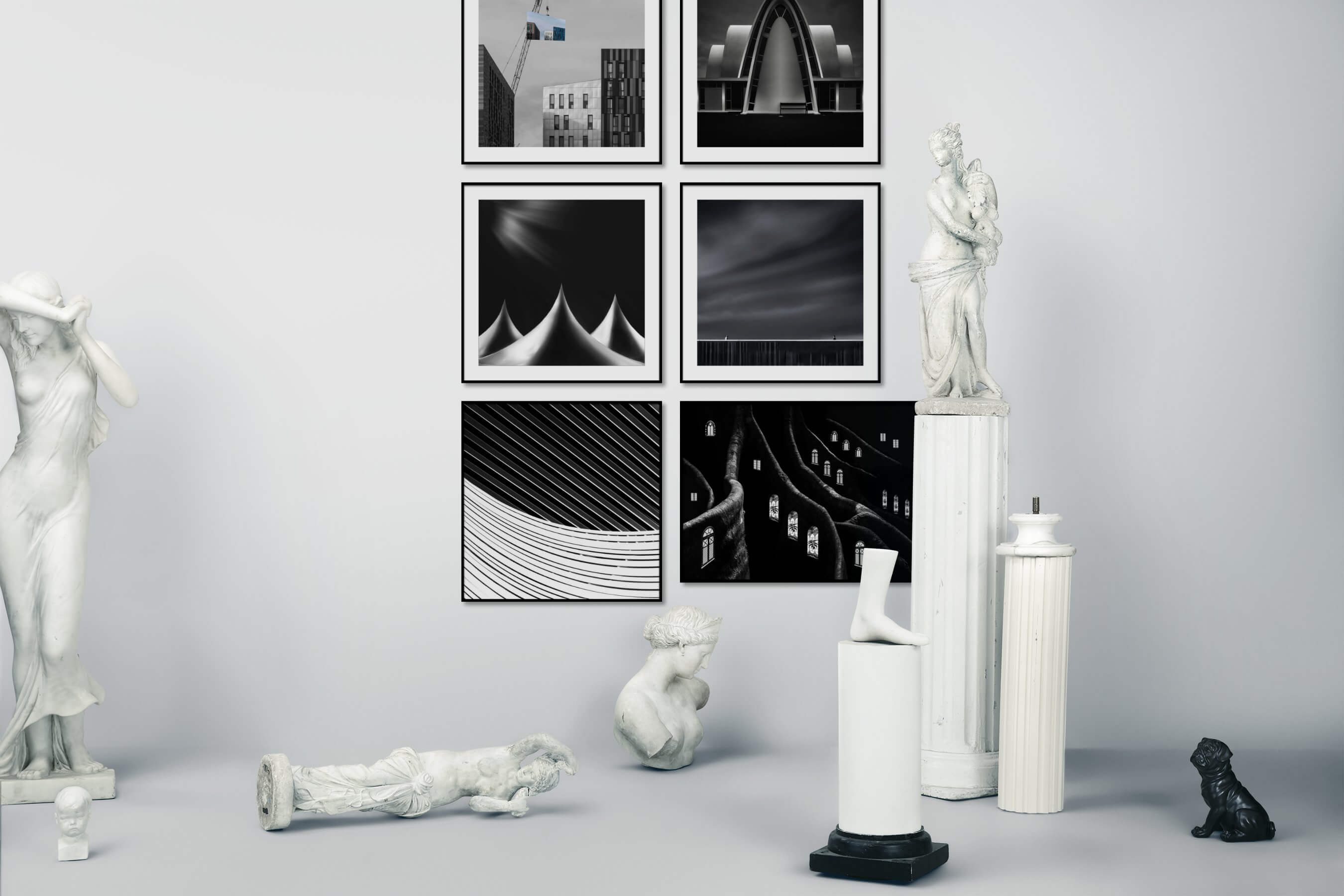 Gallery wall idea with six framed pictures arranged on a wall depicting City Life, Black & White, For the Minimalist, For the Maximalist, Artsy, and Dark Tones