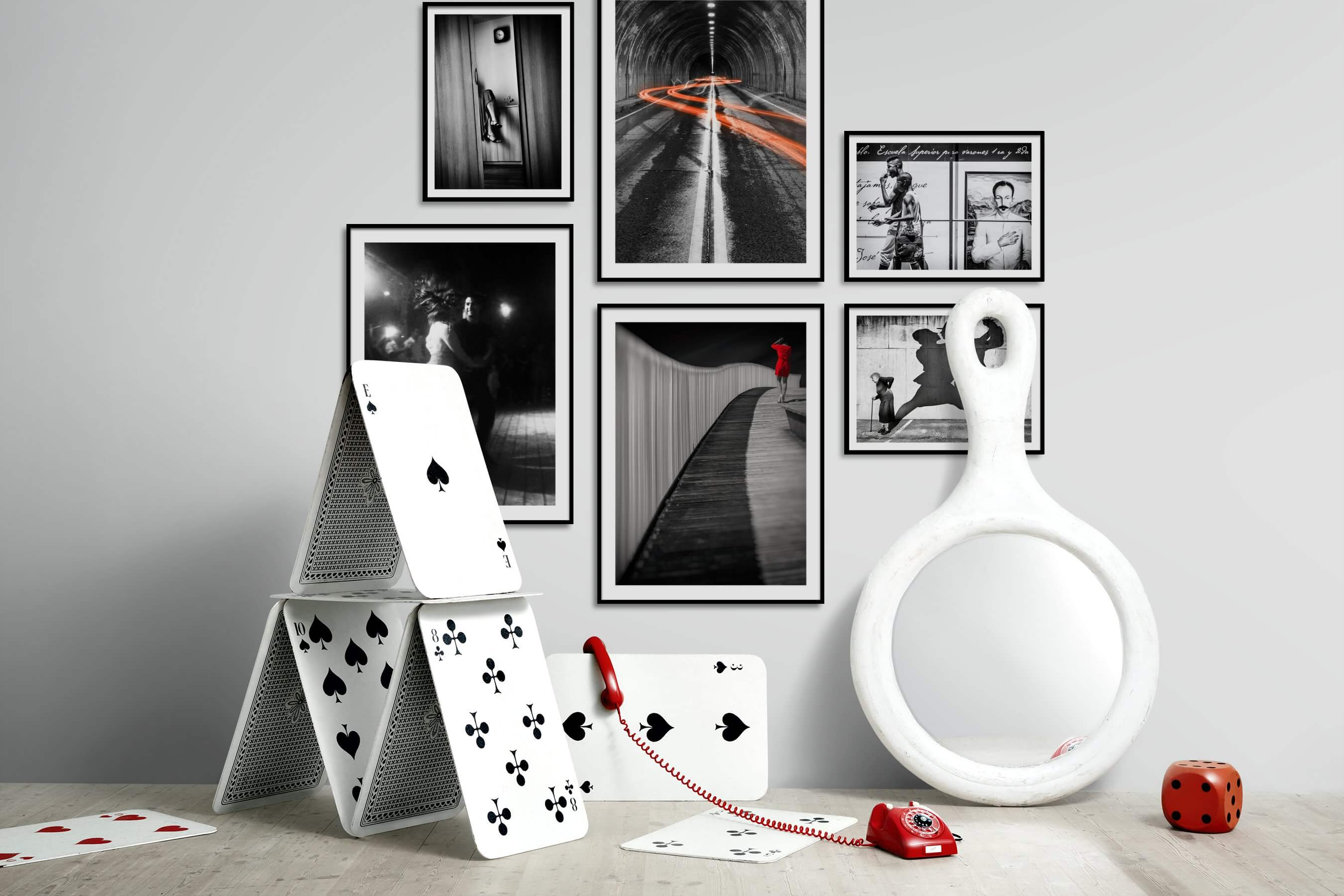 Gallery wall idea with six framed pictures arranged on a wall depicting Artsy, Black & White, For the Moderate, City Life, and Fashion & Beauty