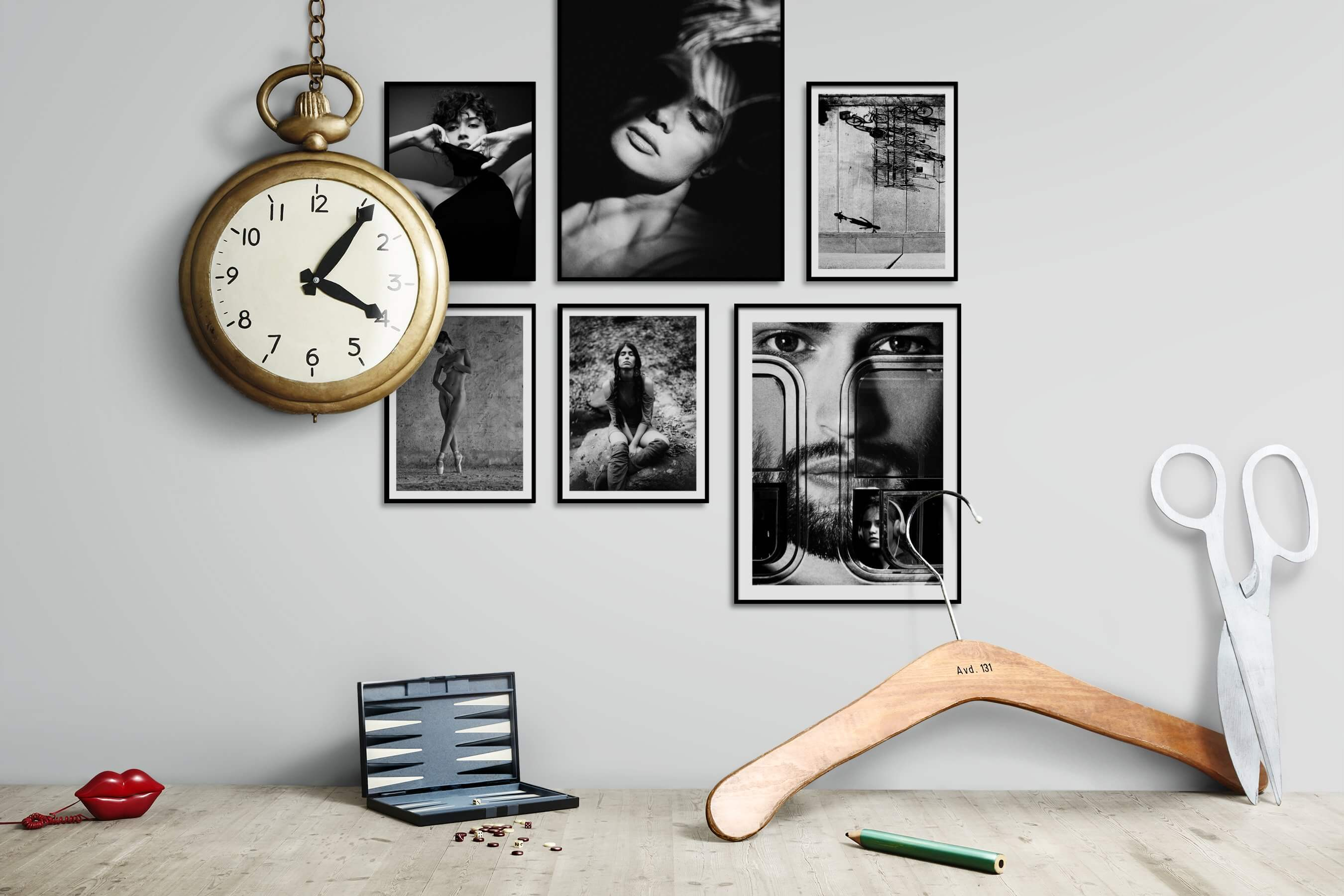Gallery wall idea with six framed pictures arranged on a wall depicting Fashion & Beauty, Black & White, Artsy, and City Life