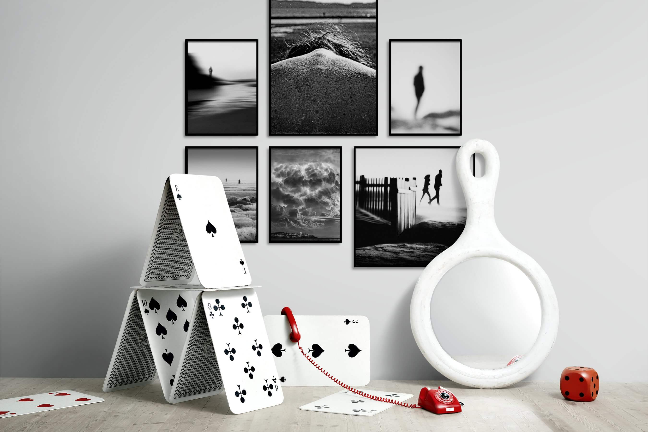 Gallery wall idea with six framed pictures arranged on a wall depicting Black & White, Artsy, Animals, Beach & Water, Country Life, Nature, and For the Minimalist