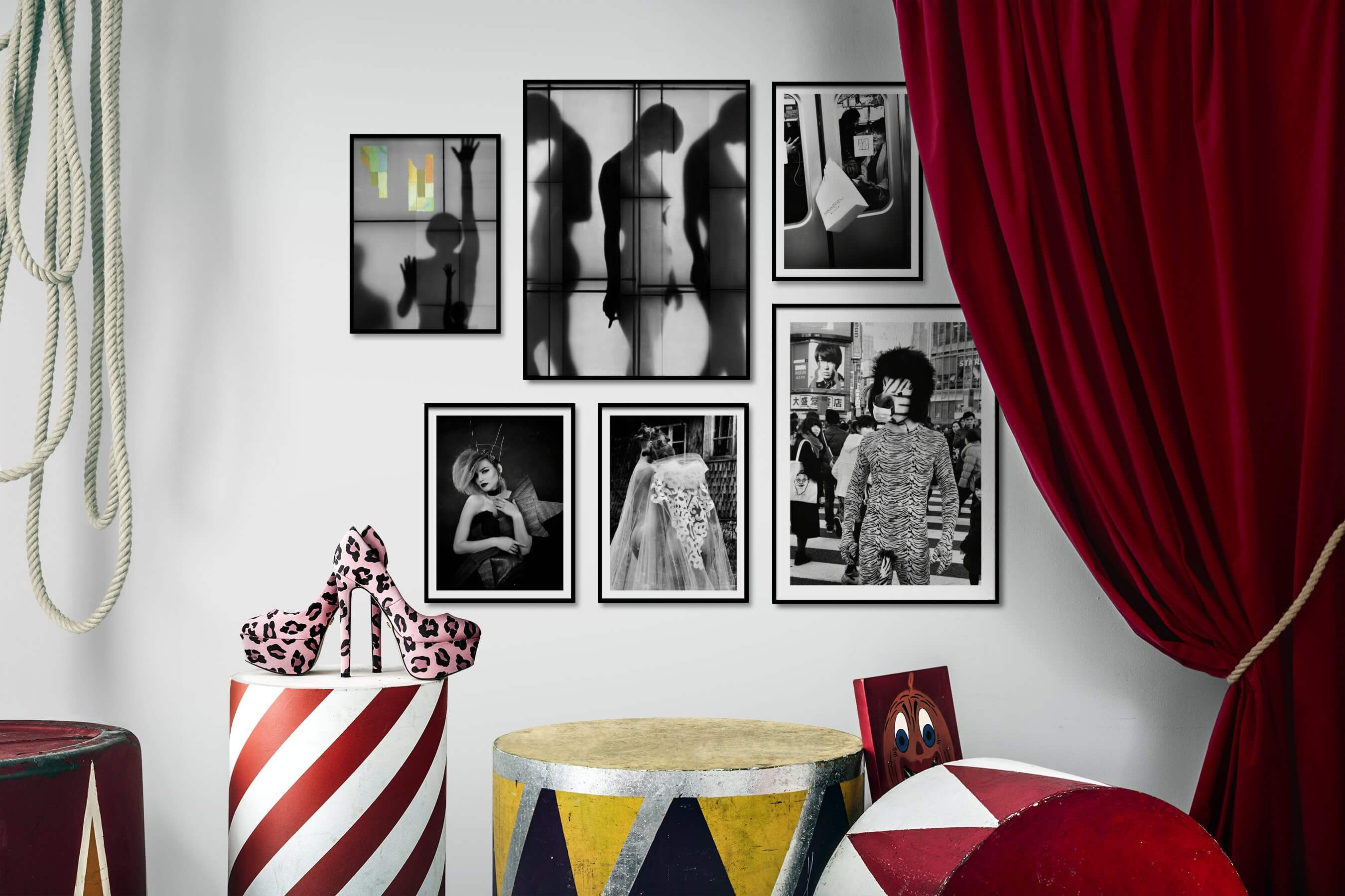 Gallery wall idea with six framed pictures arranged on a wall depicting Artsy, For the Moderate, Black & White, Fashion & Beauty, and City Life
