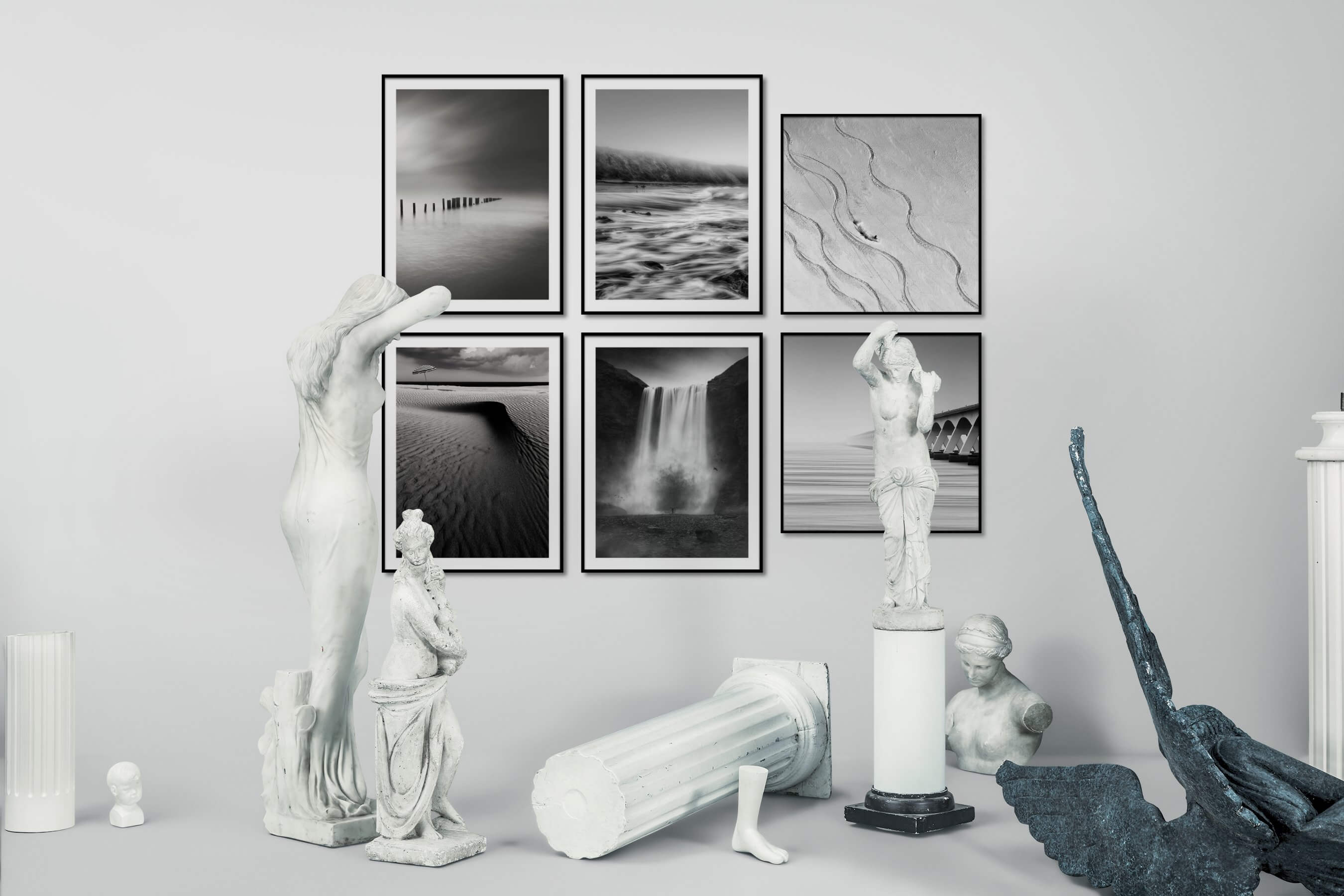 Gallery wall idea with six framed pictures arranged on a wall depicting Black & White, Beach & Water, Mindfulness, For the Minimalist, and Nature