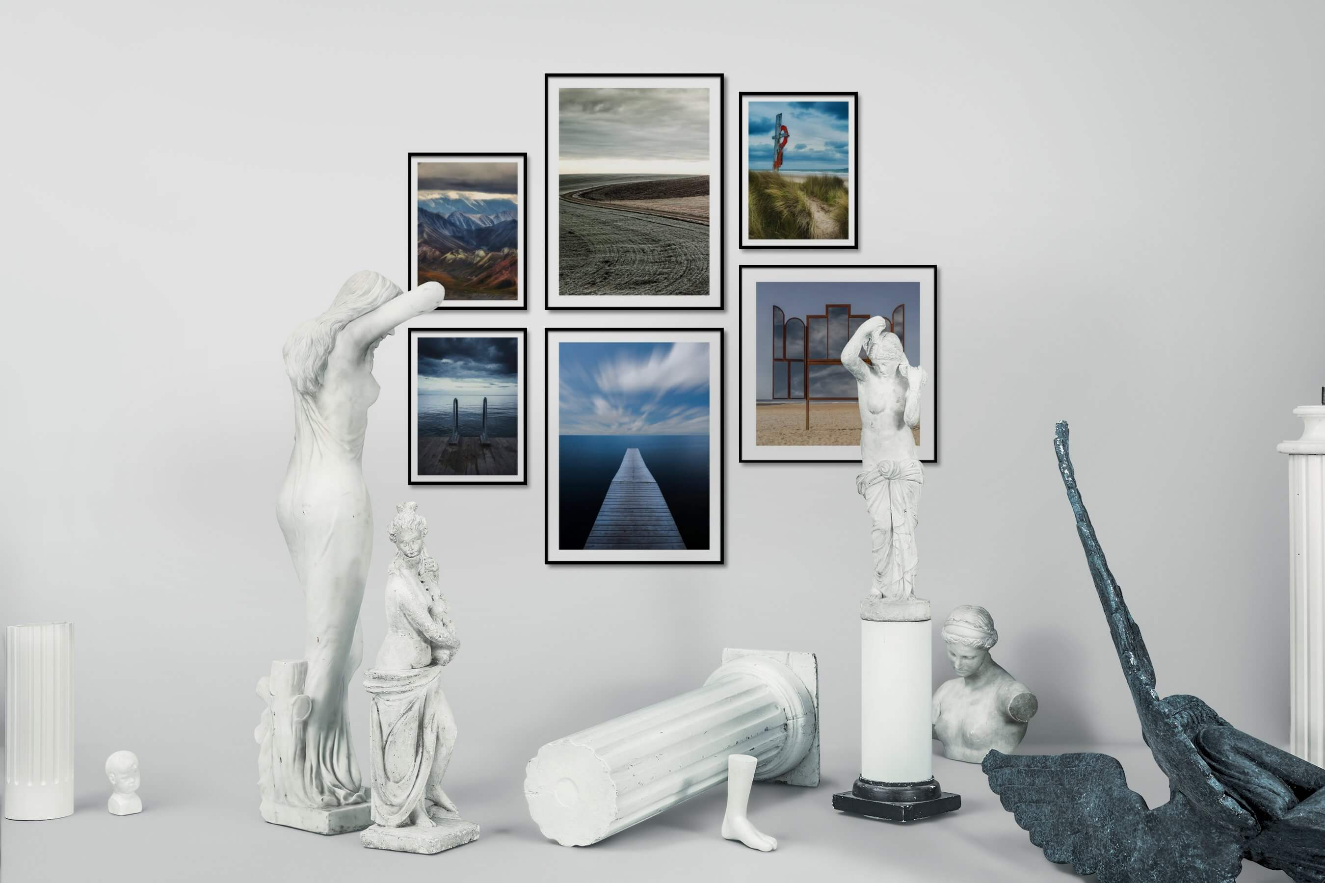 Gallery wall idea with six framed pictures arranged on a wall depicting Nature, Country Life, Mindfulness, and Beach & Water