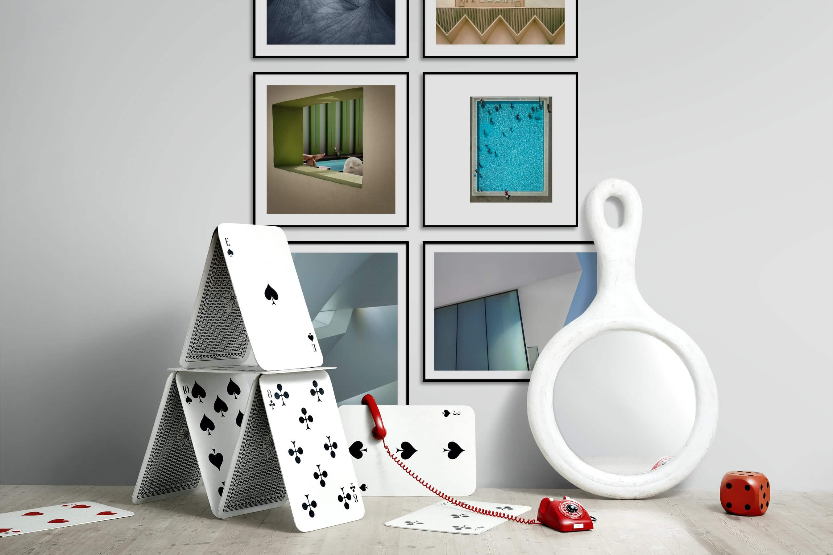 Gallery wall idea with six framed pictures arranged on a wall depicting Black & White, For the Moderate, City Life, Artsy, and Beach & Water